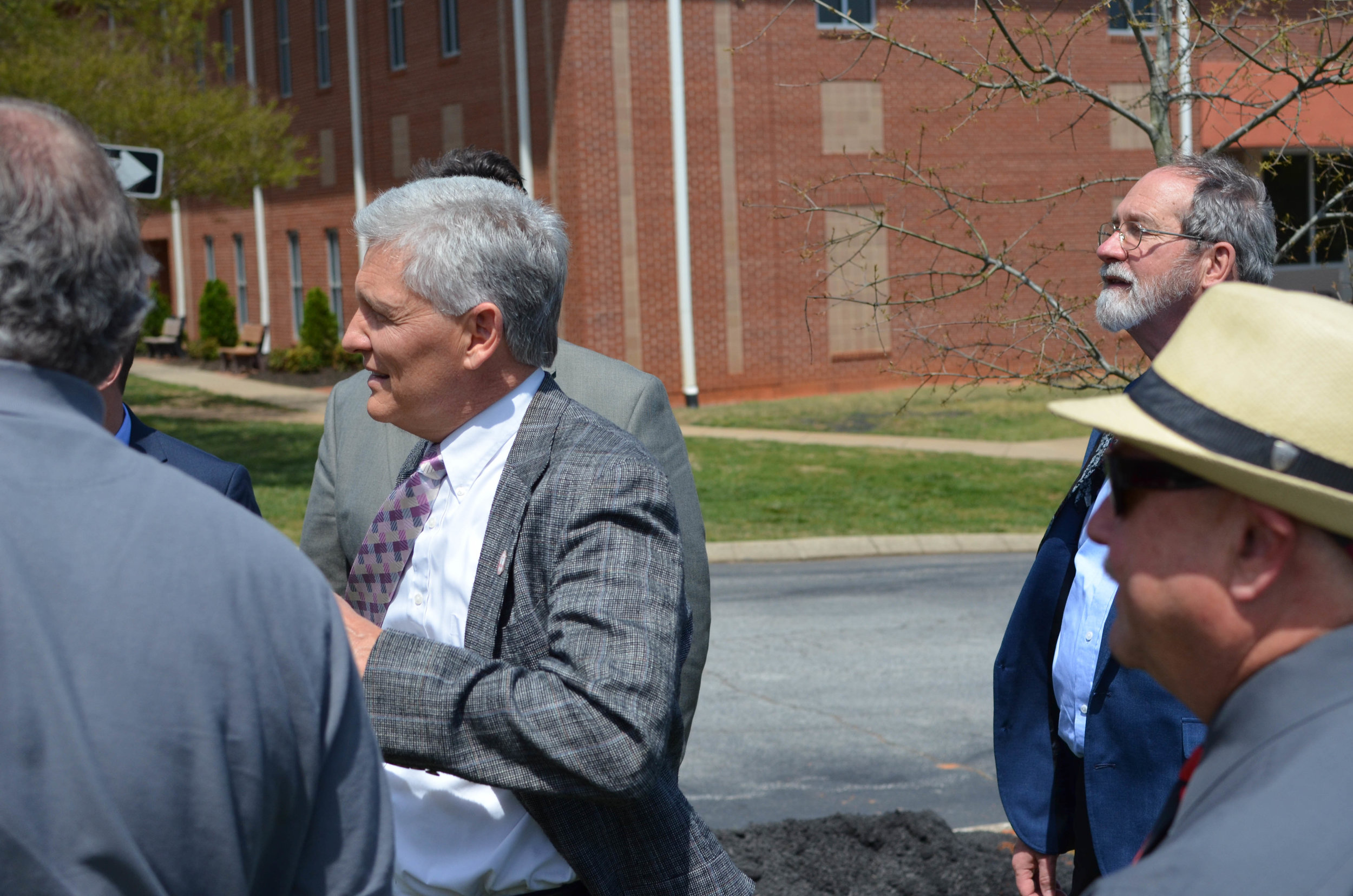 Professor Curtis Horn converses with colleagues after plantation.