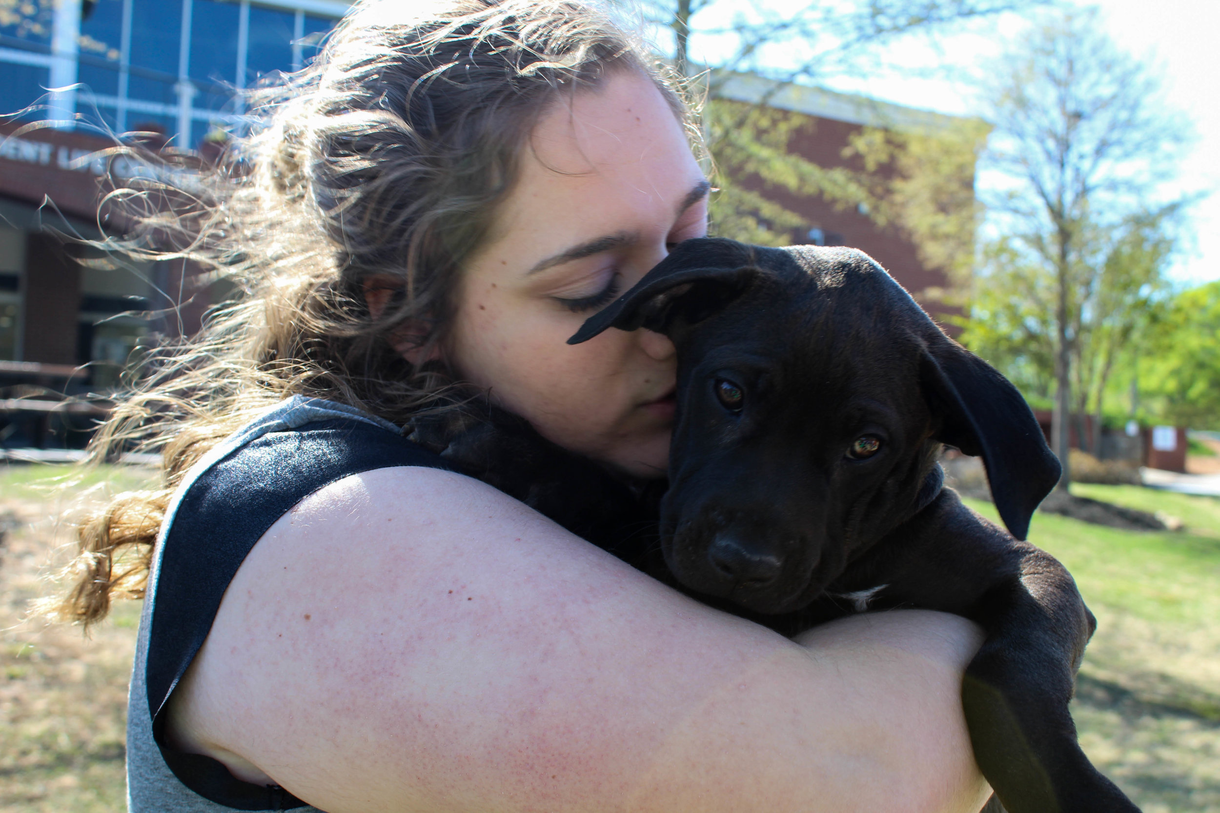 Nicole Pollard, an early childhood education major, holds one of the girl puppies.