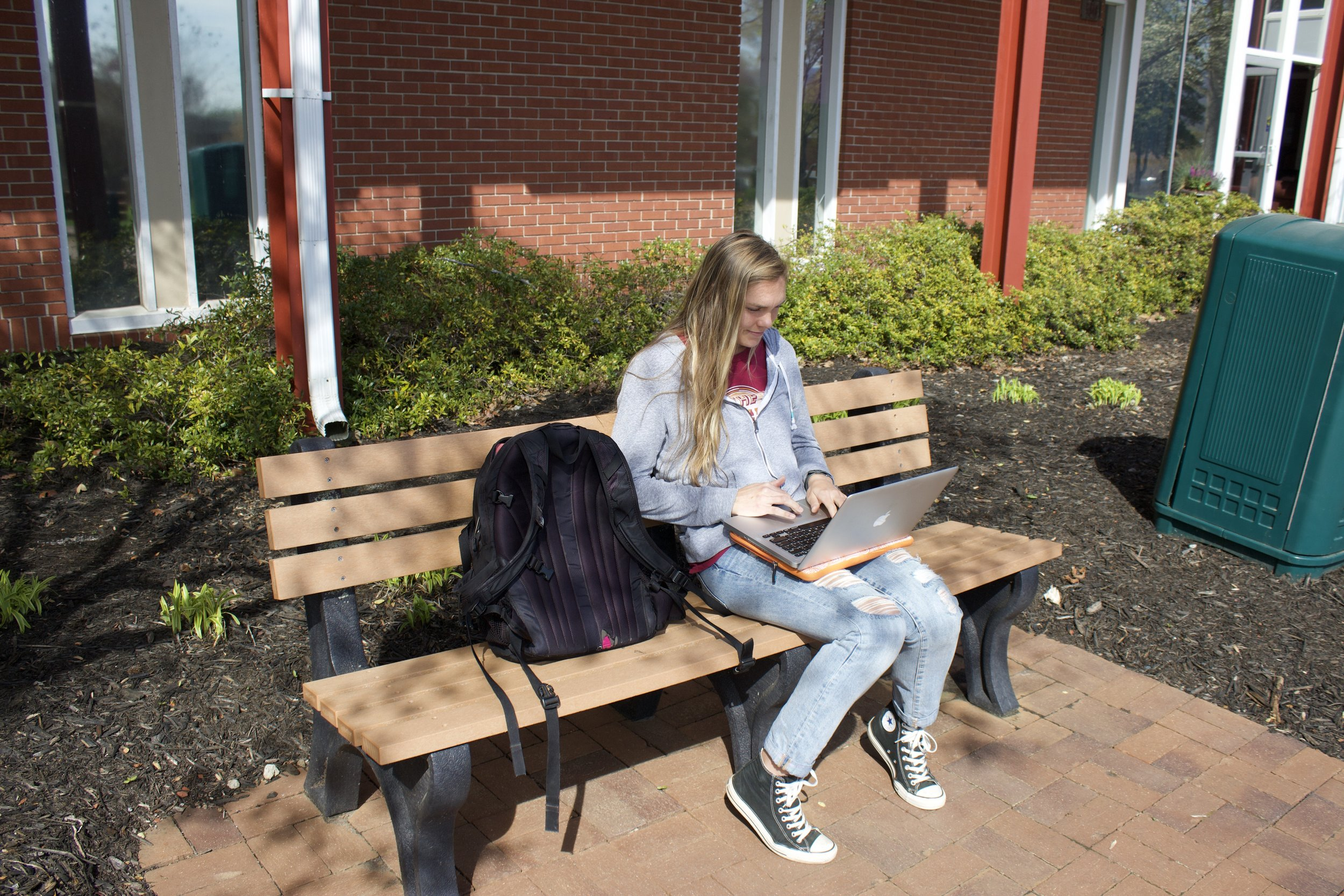 Senior Leah Austin takes advantage of the good weather while studying for exams.