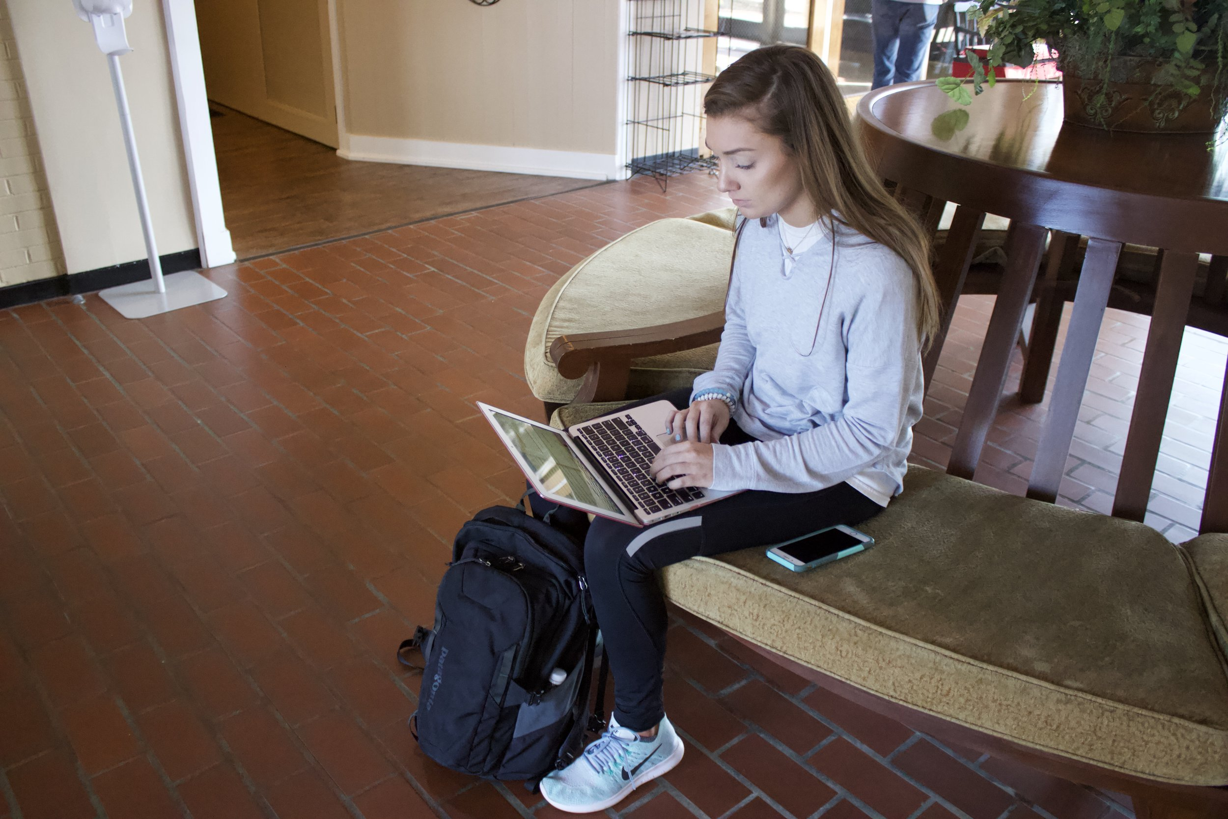 Sophomore Maddie Richardson adds the finishing touches to an essay before class.