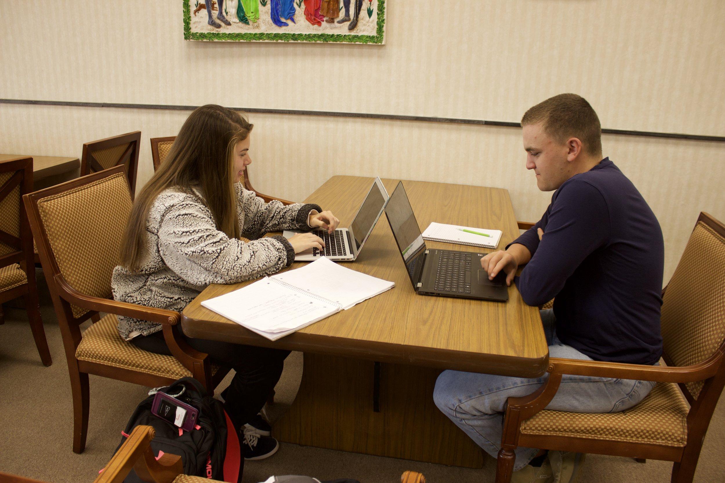 Kristen Emery and Harrison Blake Carraher work on homework in the library.