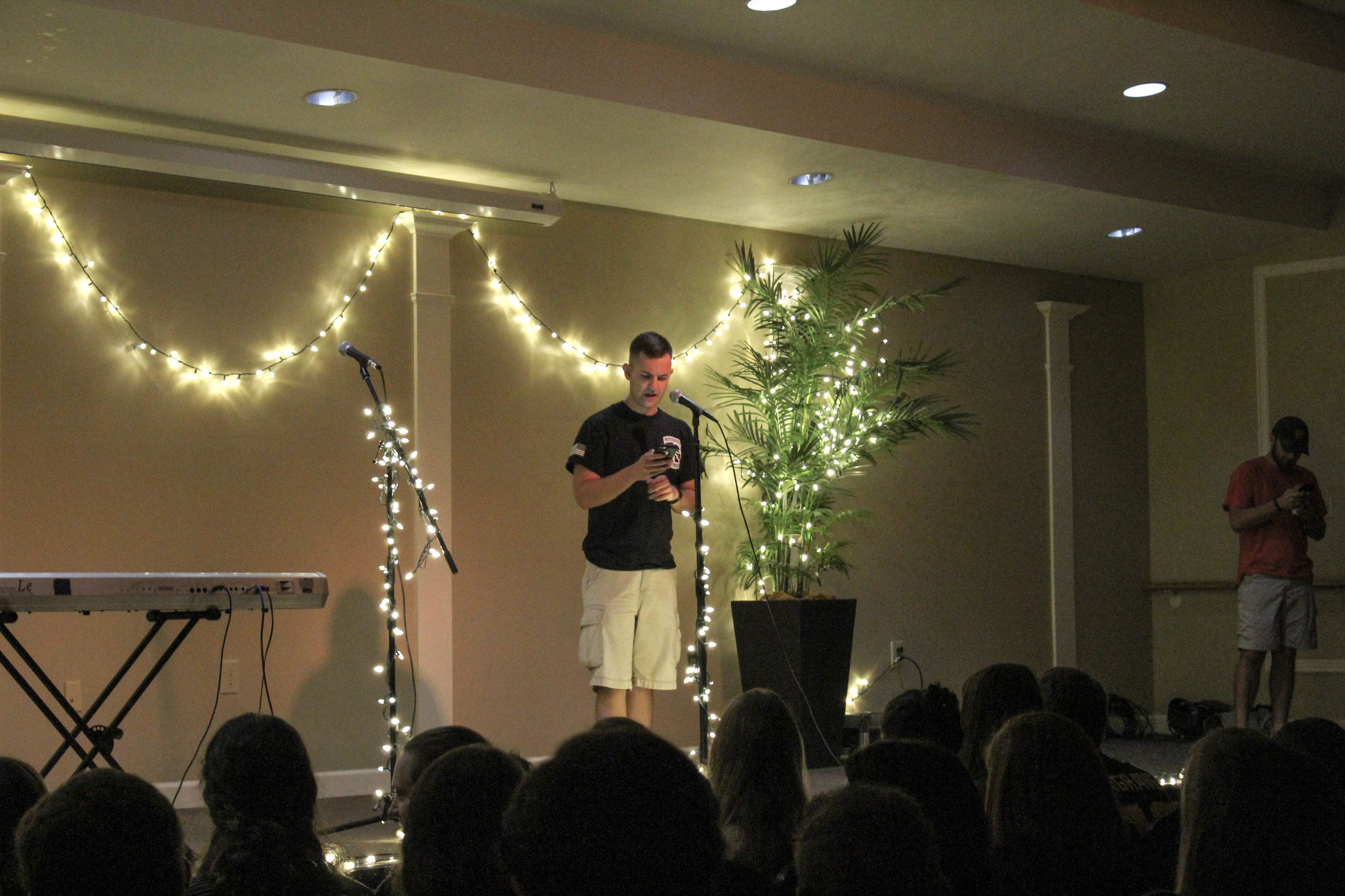 Senior, Nathan Burton, opened the coffeehouse up by reading an original poem on the crucifixion.