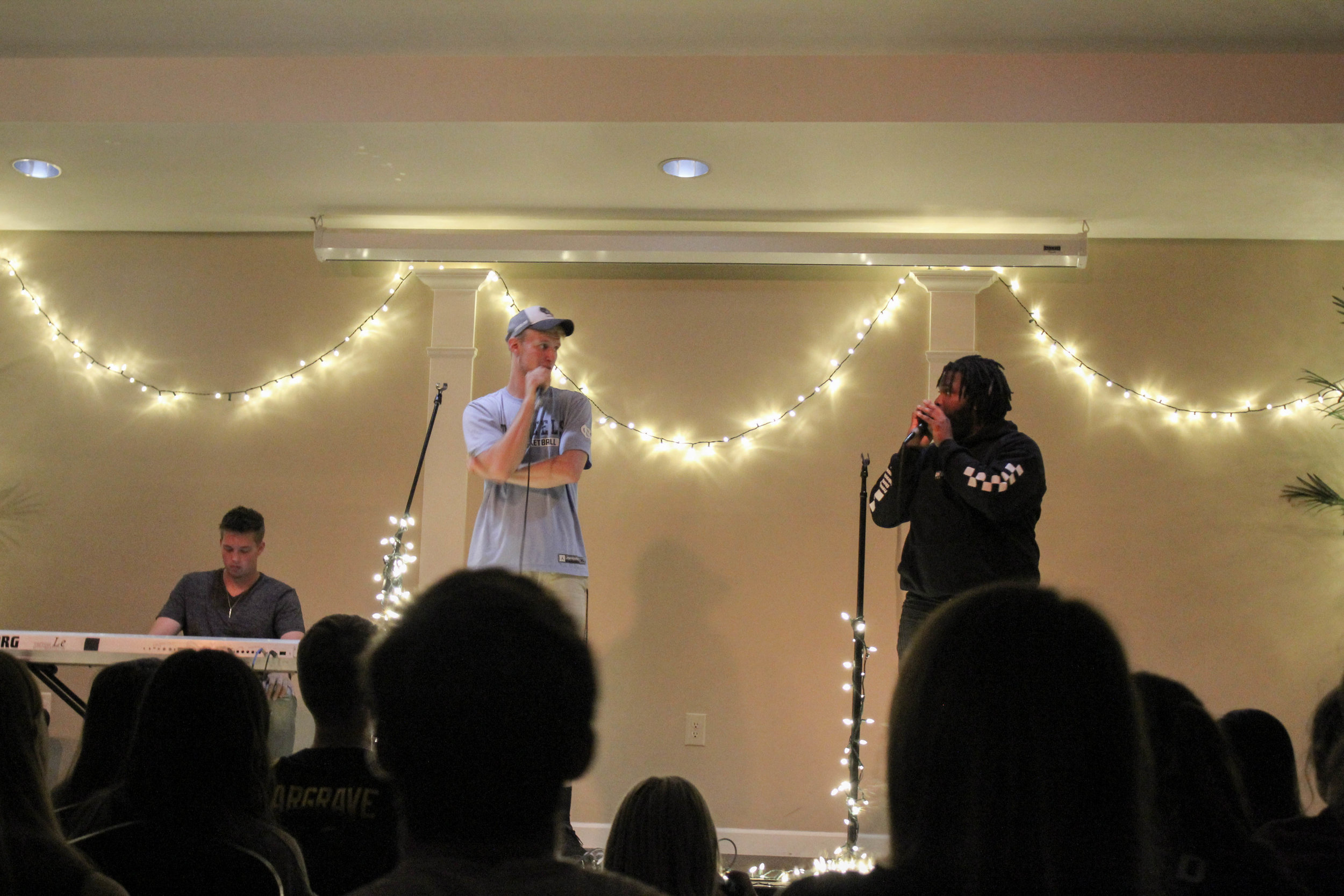 Juniors, Ben Hamsho and Mykel Scott talk to the crowd about the Crusader football team. They discussed how the football team moved to the Gulf South Conference and urged students to attend the first home game the following week to show support.