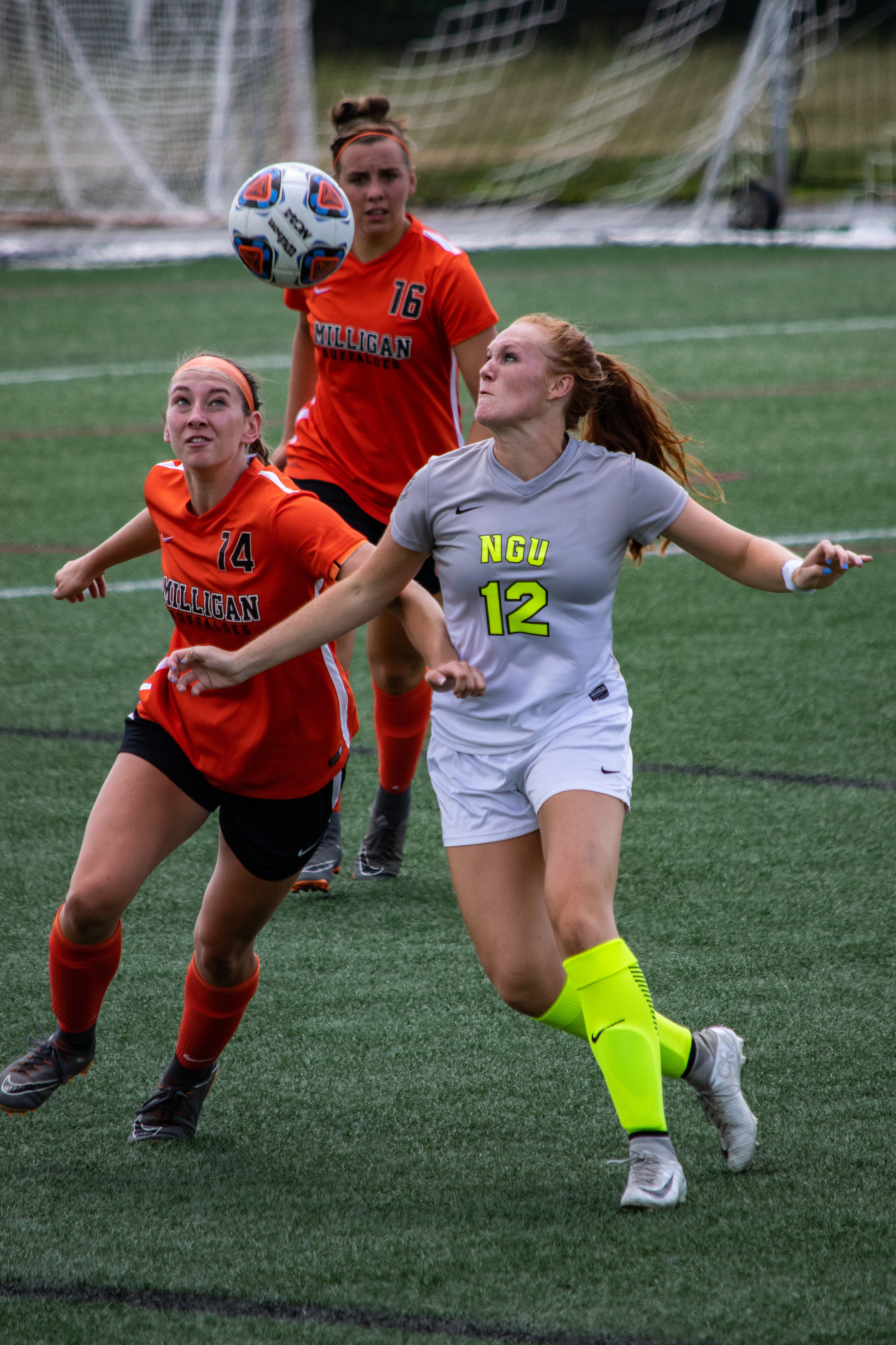 #12 Mary Puryear fights for possession for the ball.