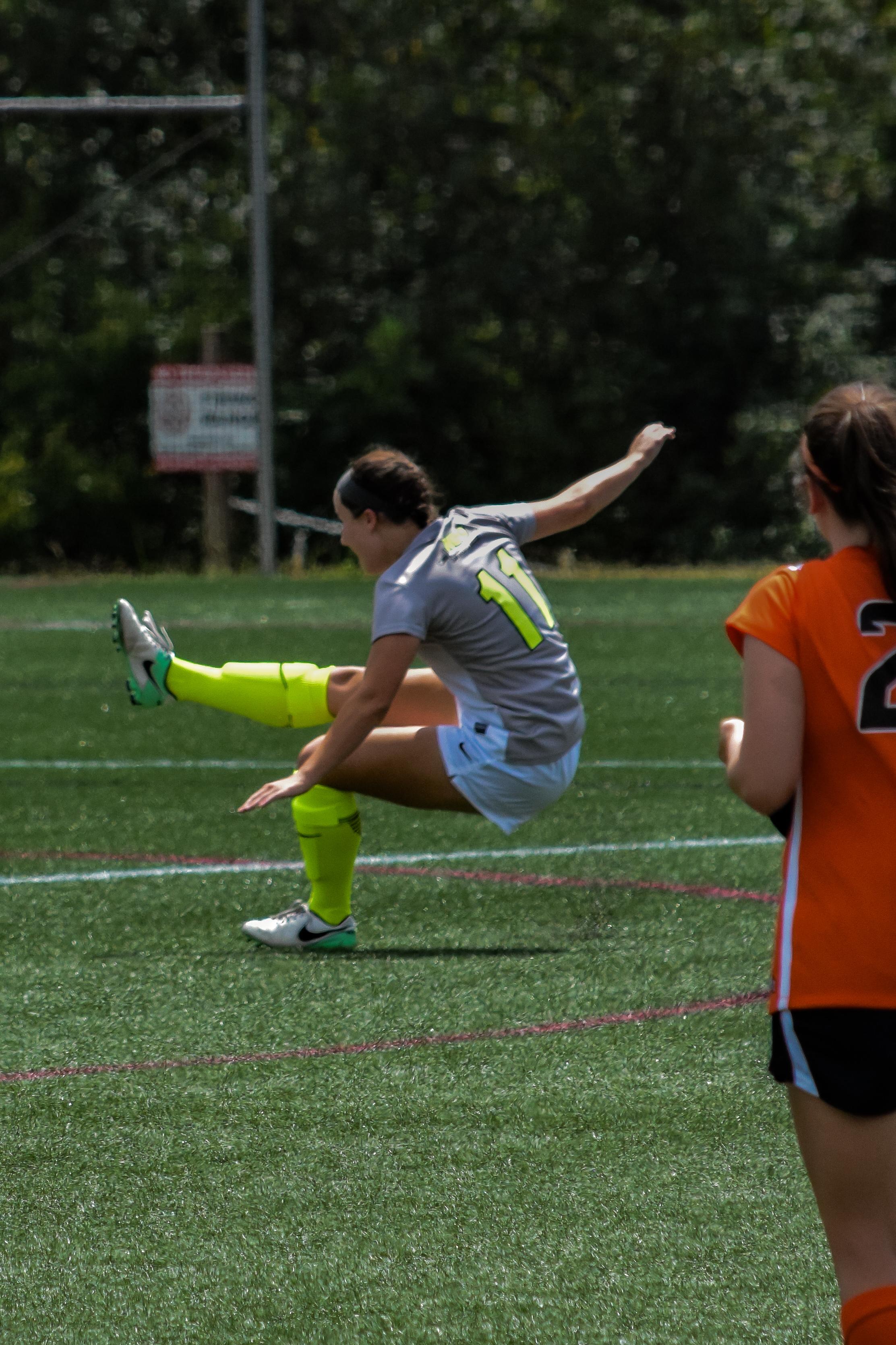 #11 Ayden Boatwright shows off her balancing skills after she kicks the ball.