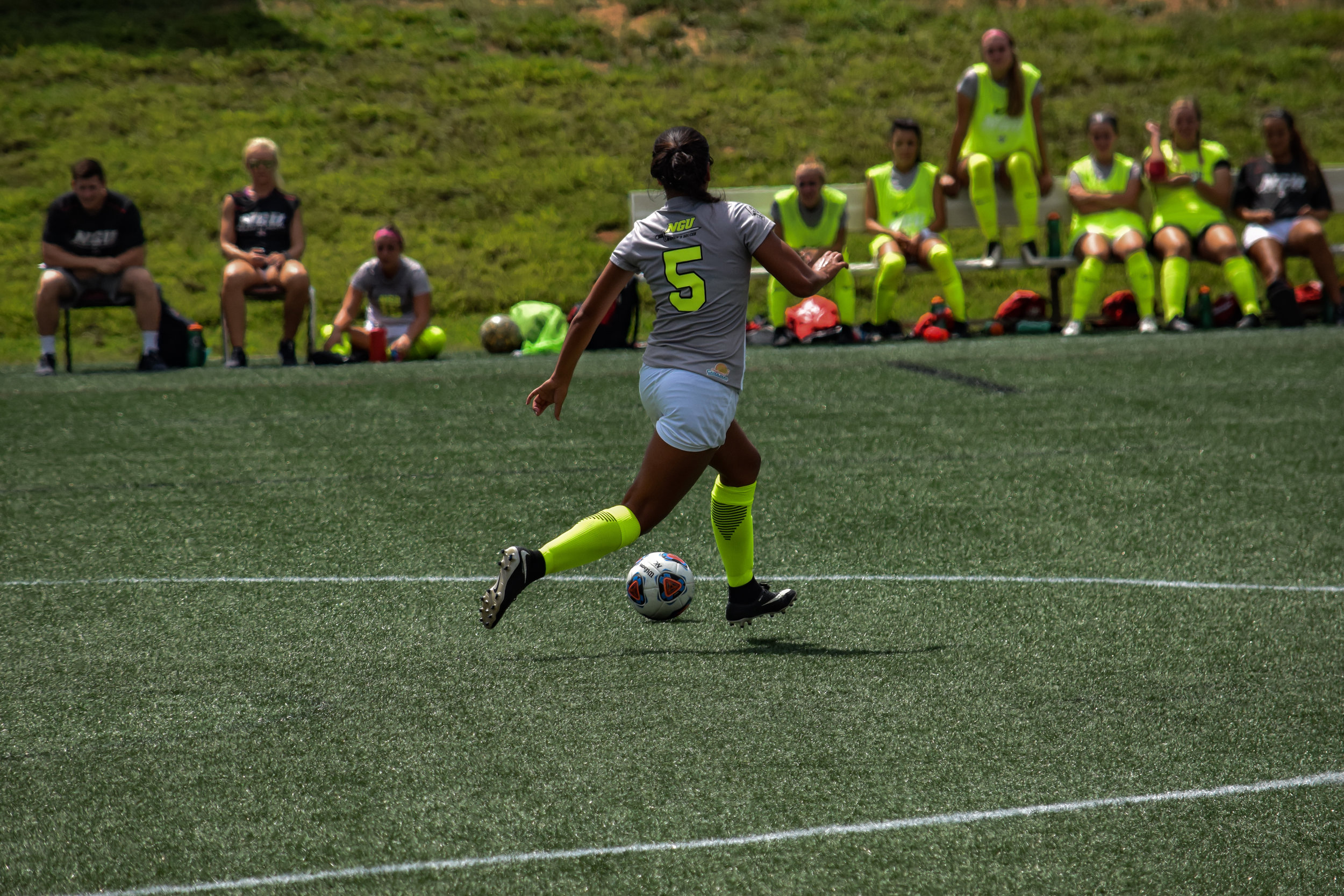 #5 Joelle Chick prepares to plant her foot in order to kick the ball to another teammate.