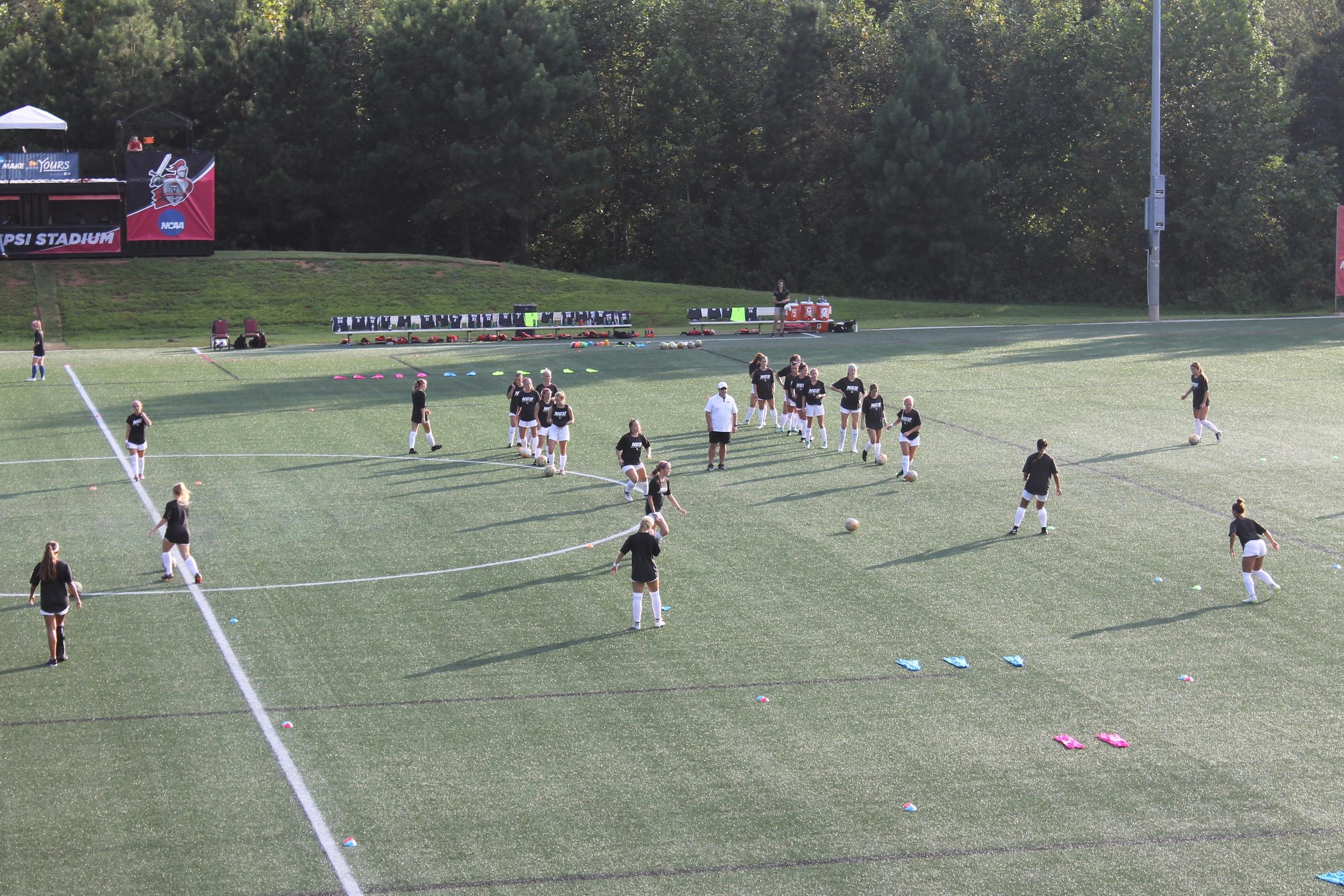NGU ladies soccer team warming up before the game; preparing to play against Lander University.