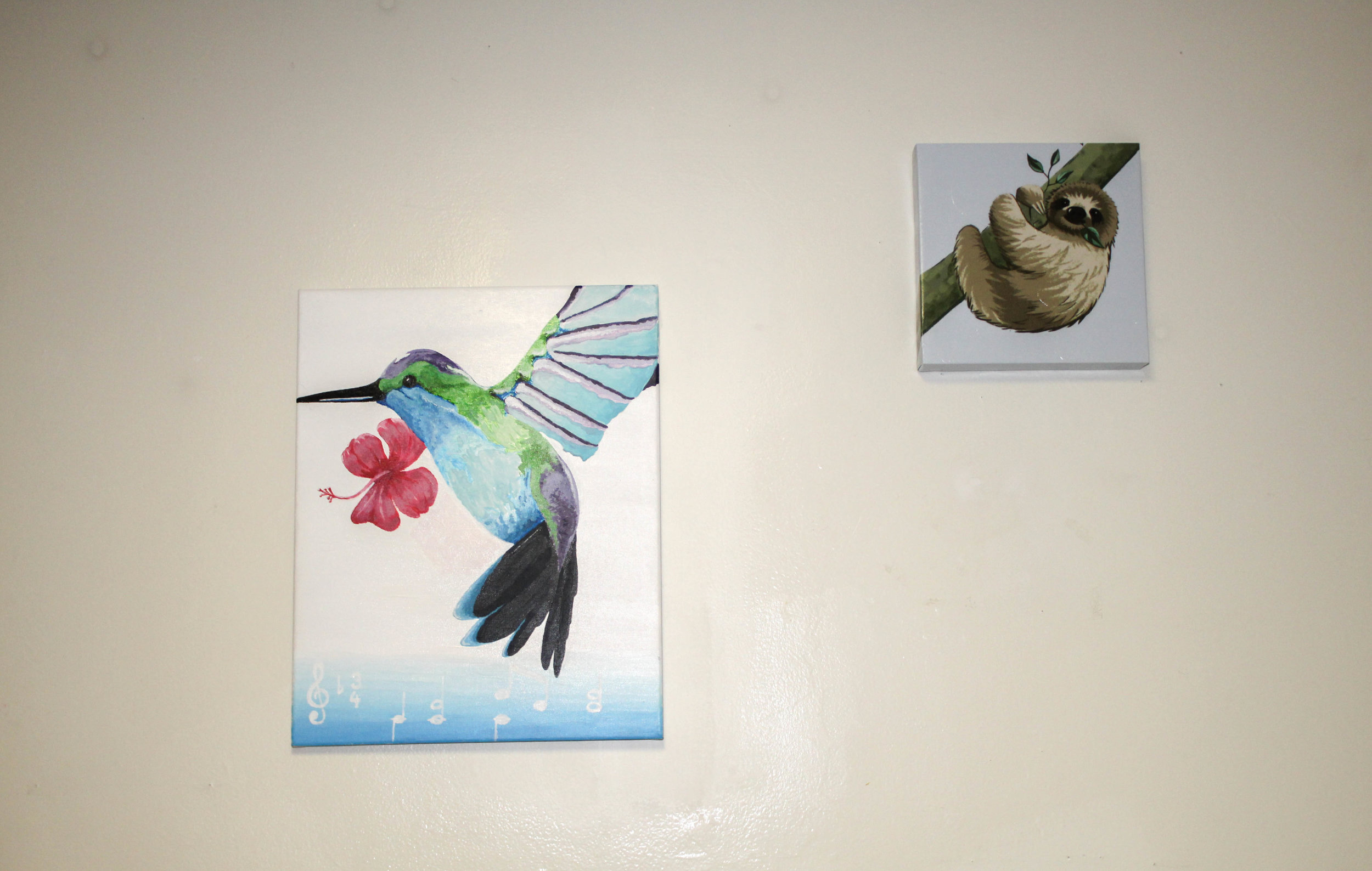 Gibson also displays pictures of different animals in her room. The painting of the sloth was painted by her friend.