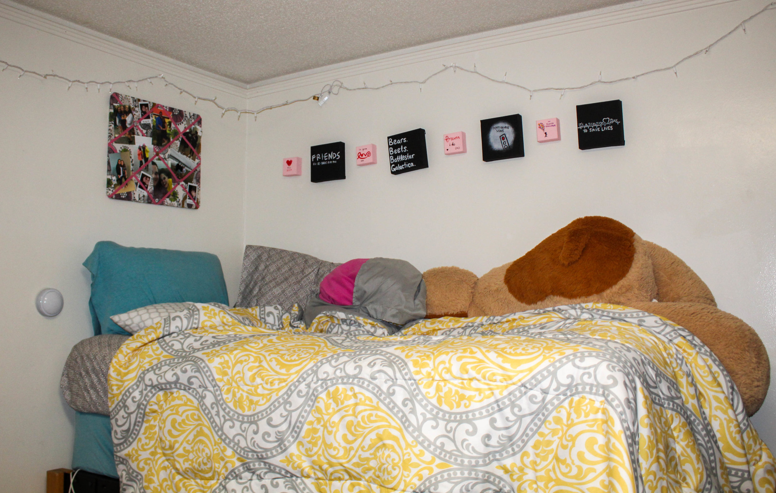 Victoria Darr, junior, shows off her favorite color, yellow, by the choice of vibrant comforter.