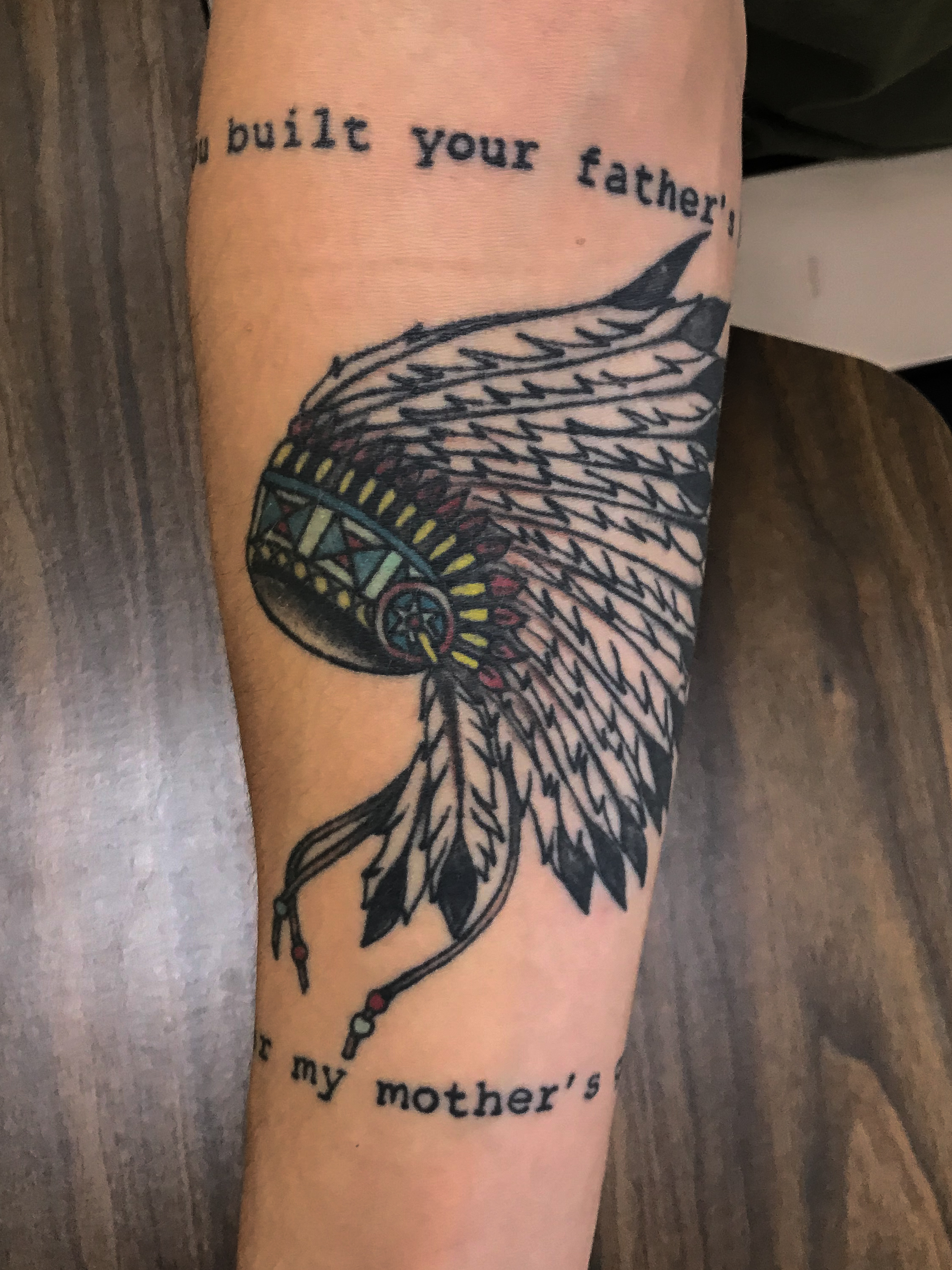 "This is Ethan Clark's tattoo on his right forearm. The writing is lyrics that say, ""You built your father's tomb on my mother's grave."" Clark got this tattoo to represent Manifest Destiny during Westward Expansion. Being a member of the army, this will remind him to step back and think about the effects of his action on the lands that are not his home."