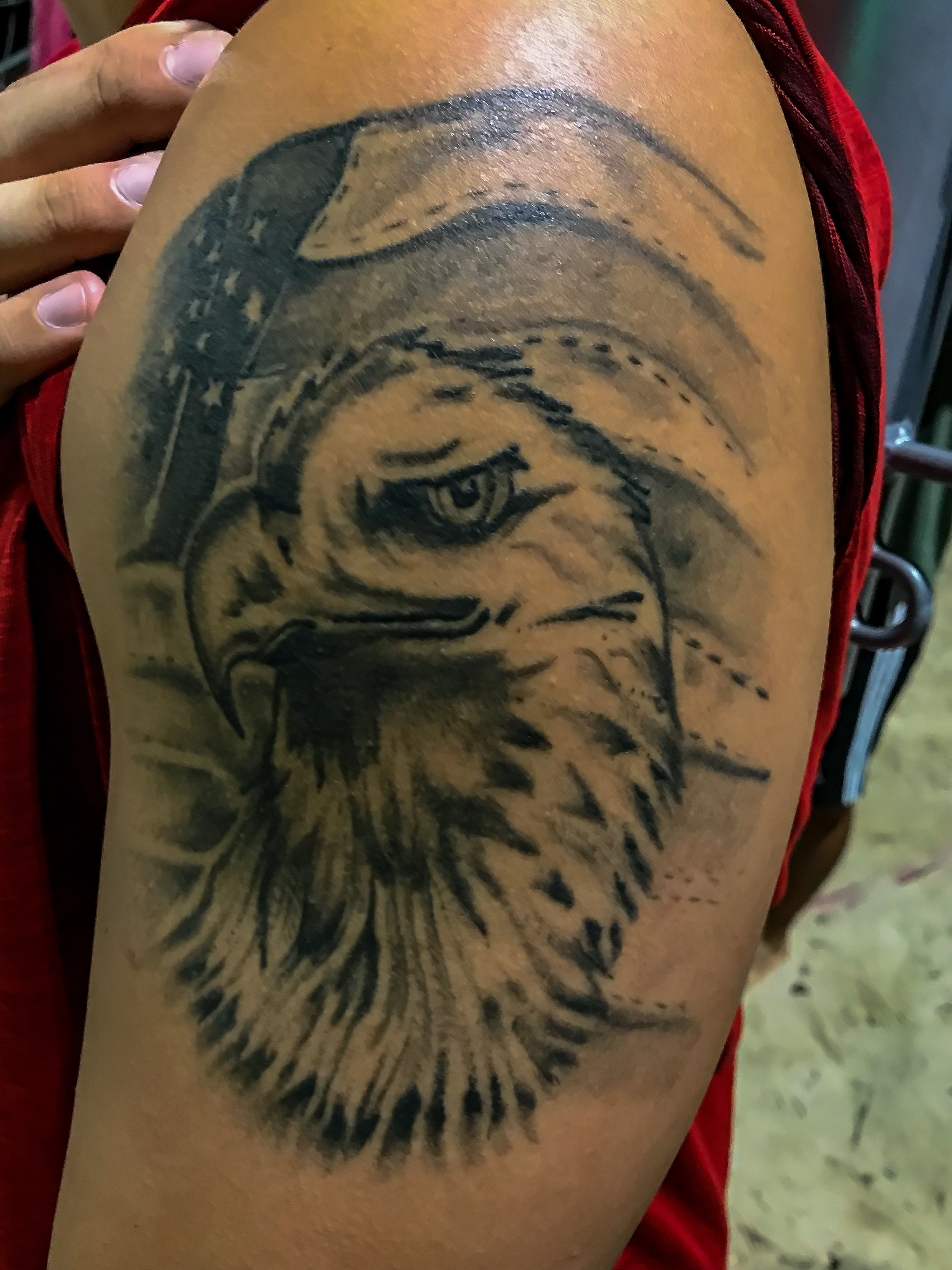 "This is one of Ian Bailey's tattoos. It is an eagle head in front of the American flag. This symbolizes his character and passion. Bailey likes to be alone but has the character to protect all. Which leads into the American flag which symbolizes power, protection for all and ""God's country'."""