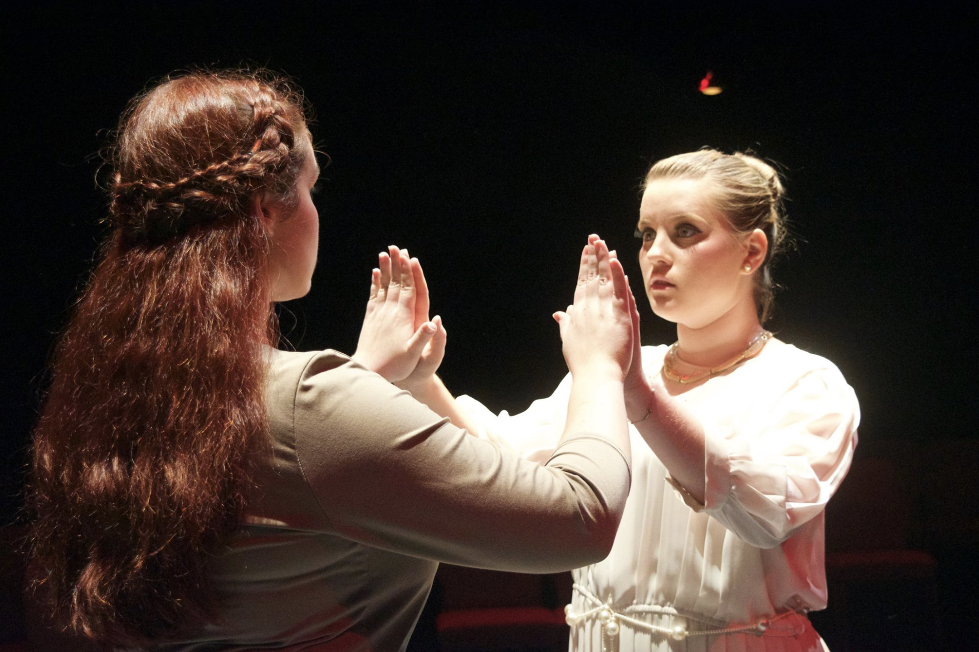 Junior, Ashlynn Butrovich and sophomore, Marlee Daniel intensely perform as Antigone and Ismene.  Picture courtesy of NGU Theatre Facebook page