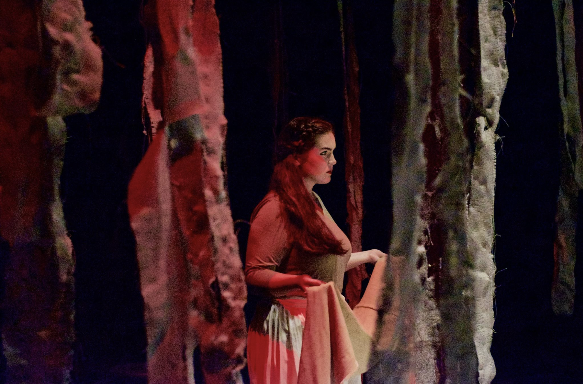 Ashlynn Butrovich (junior) glares fiercely into the audience as Antigone.  Picture courtesy of NGU Theatre Facebook page