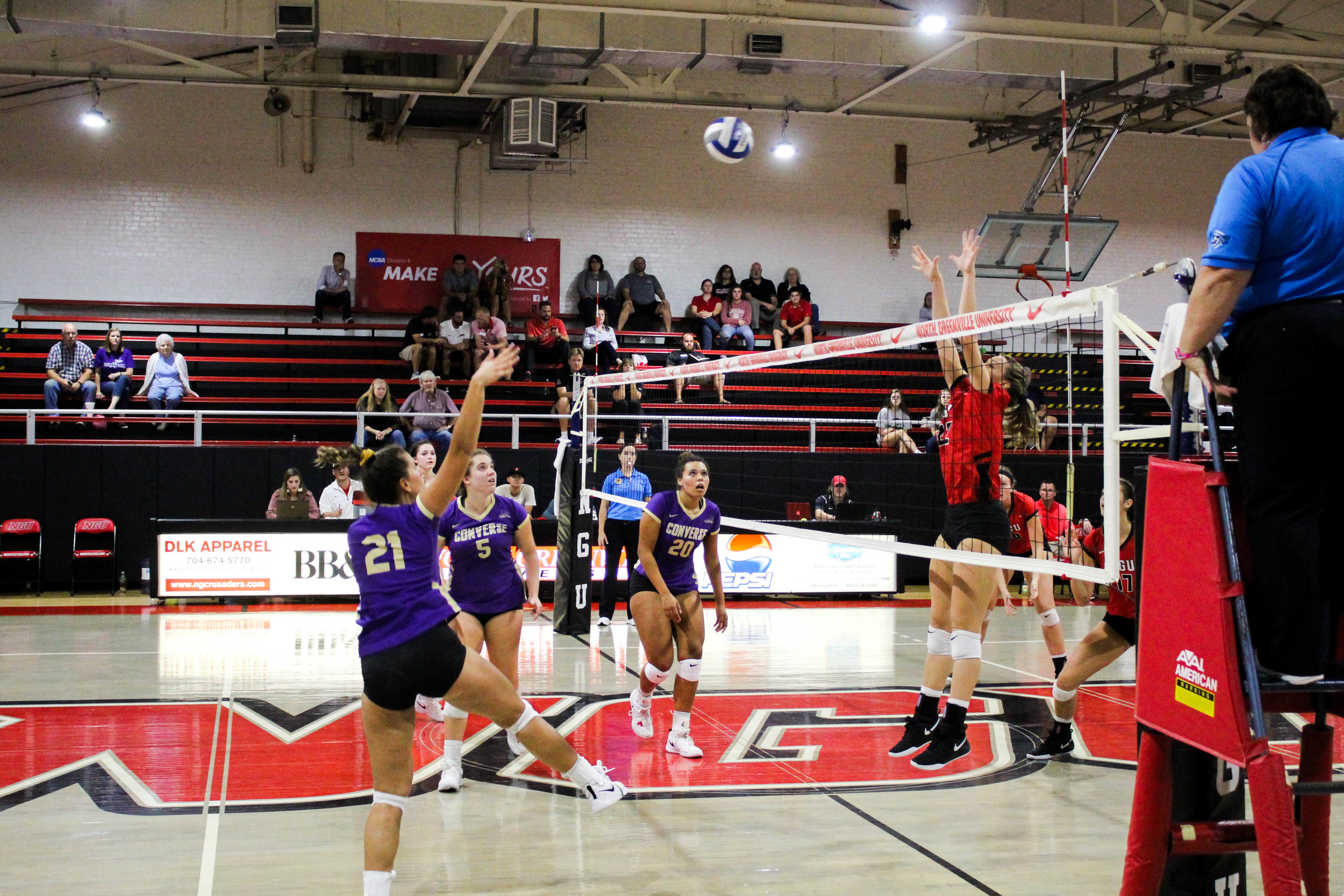 Senior, Courtney Williamson (22), jumps as she prepares to block a hit across the net.