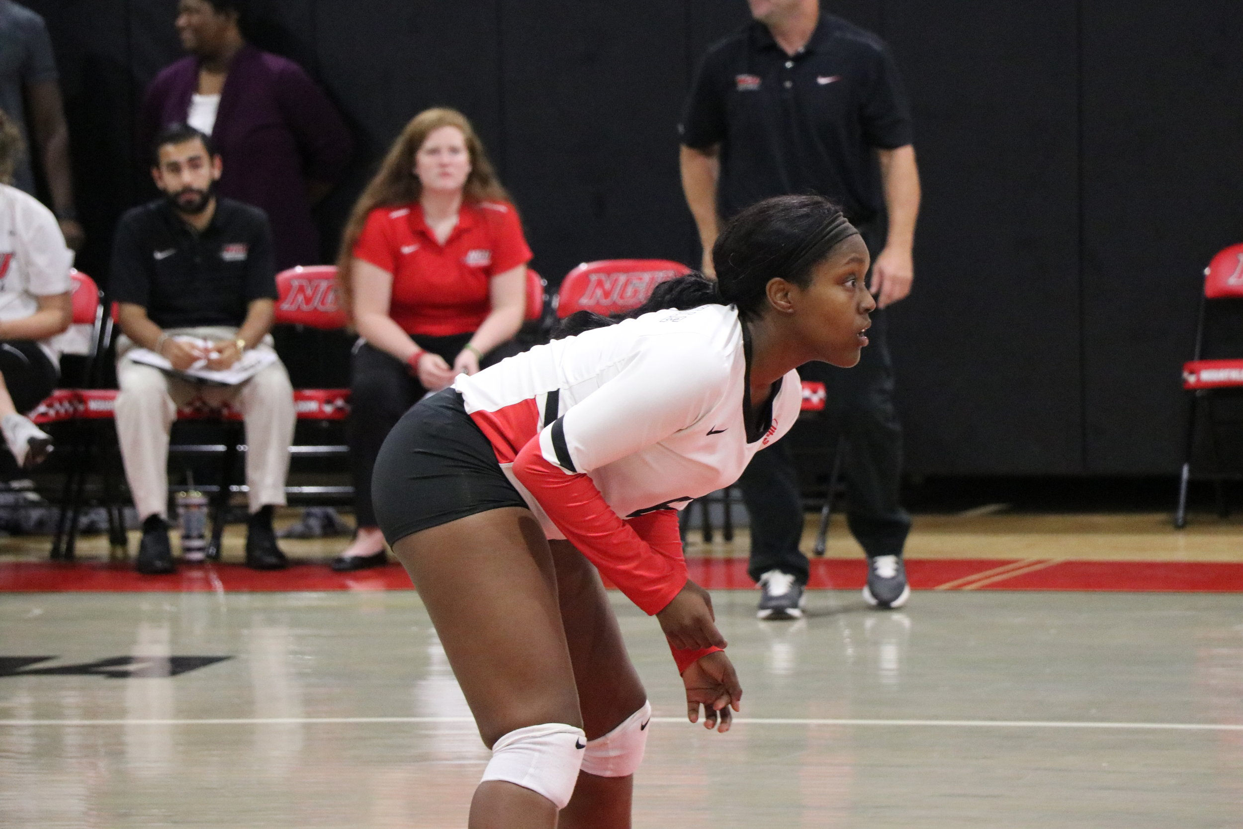 Senior, Johna Robbins (6) gets ready for the ball to be served.