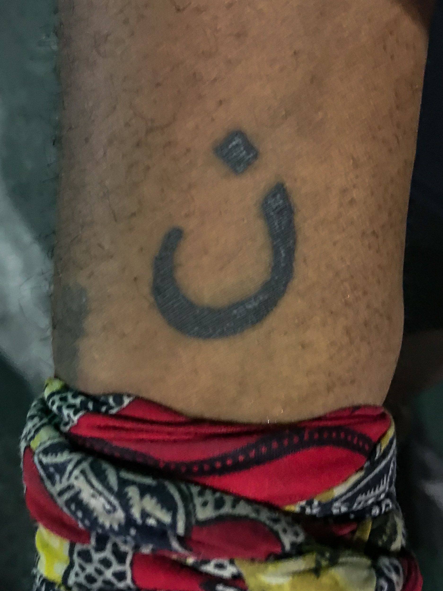 This is Mykel Perdue. This tattoo is the Arabic symbol for the letter 'N'. It is to represent the Israelites crucified a Nazarene and Perdue relates to and is a brother of all persecuted Christians around the world.