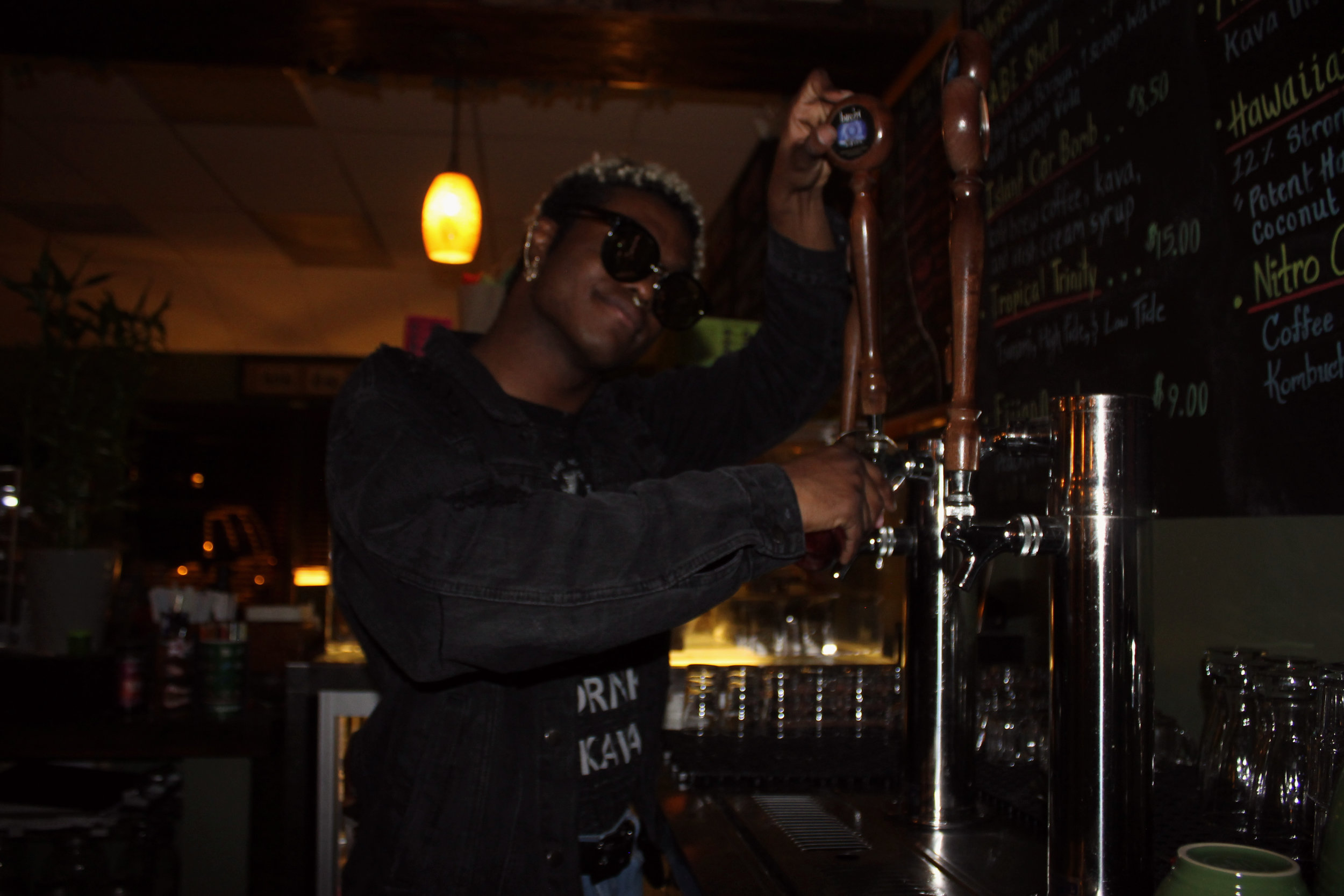 Above is Kava employee, Marcus Rivers, showing how to pour Kombucha out of tap. This drink has many health benefits and tastes great too.