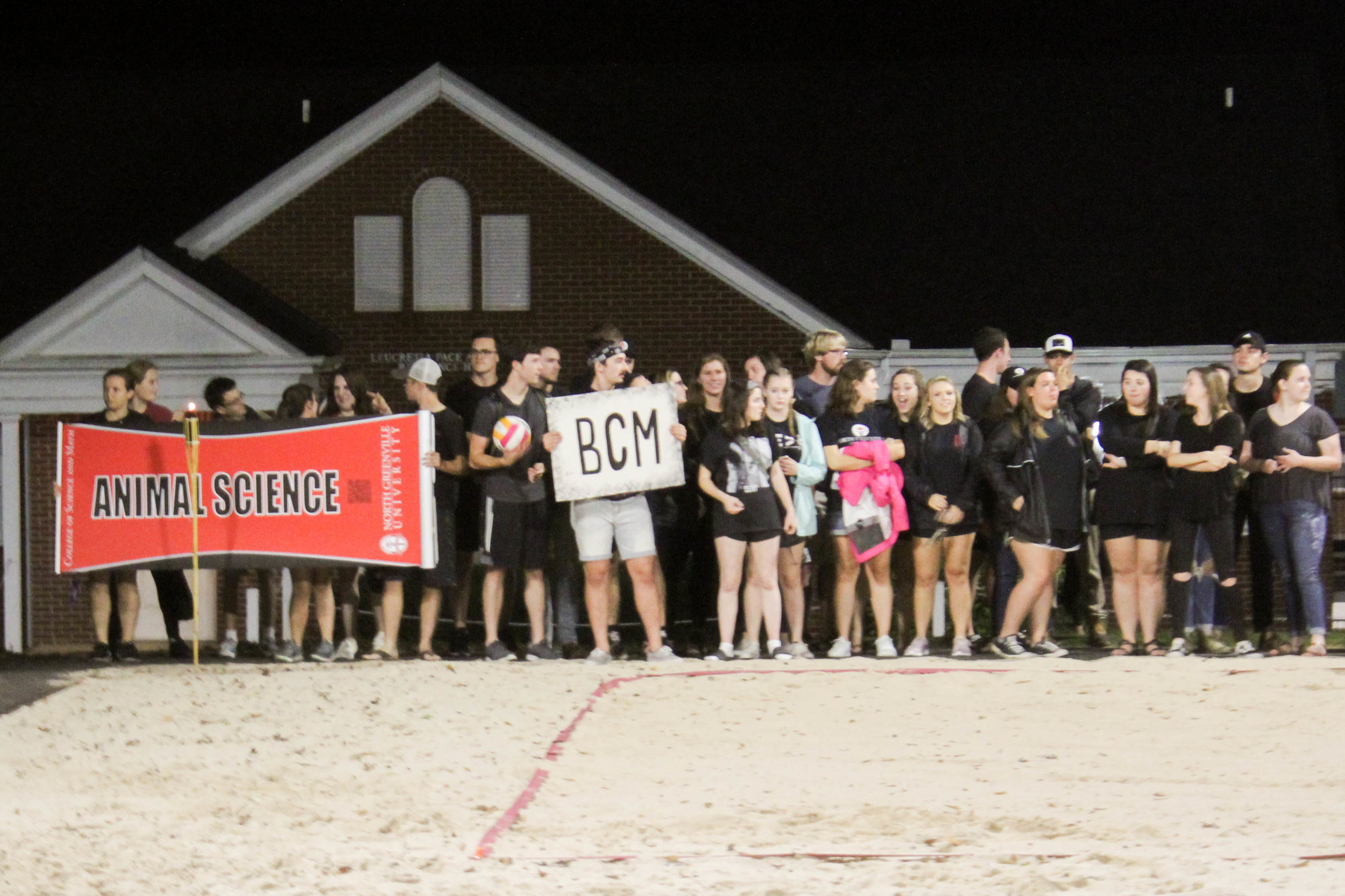 The animal science club and BCM line up and wait for the other clubs to line up.