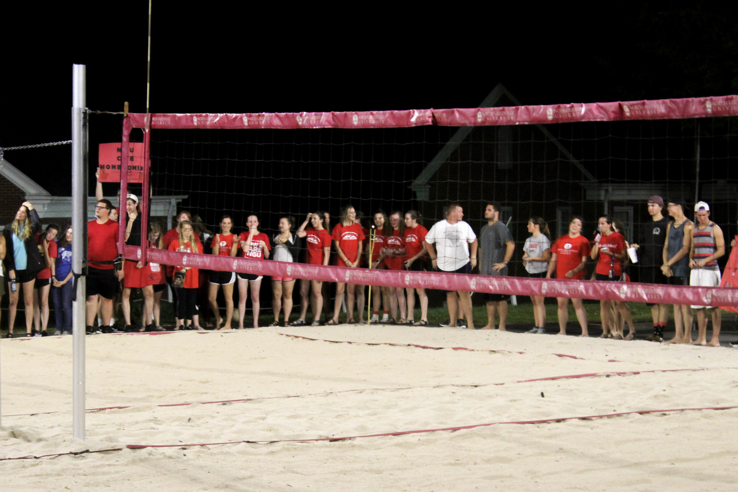 Members of the College of Education show their support for their team by lining up and cheering.