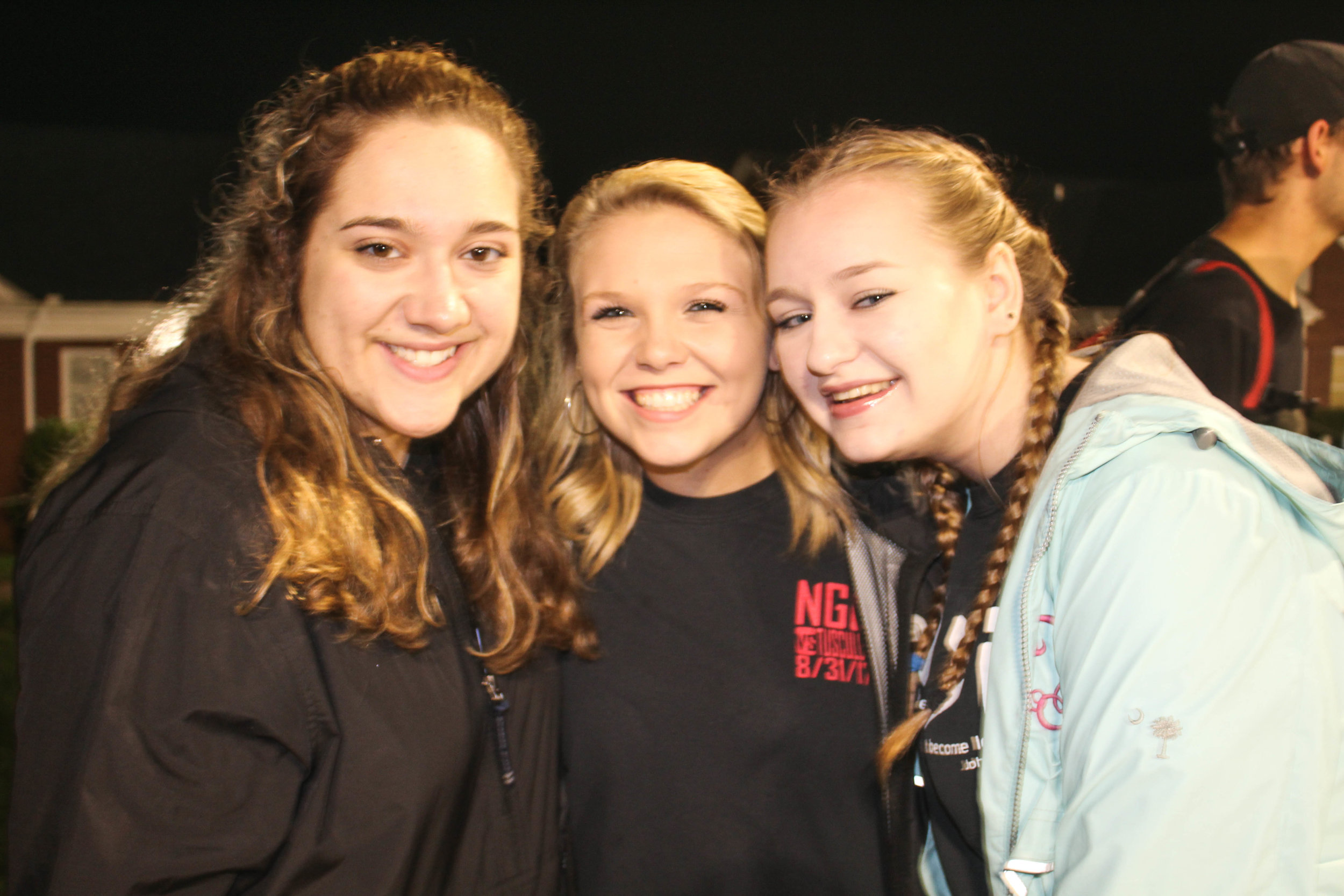 Sophomore BCM members Nicole Pollard, Mary Collins and Kelsey Truluck show their support for the BCM volleyball team as the watch them play.