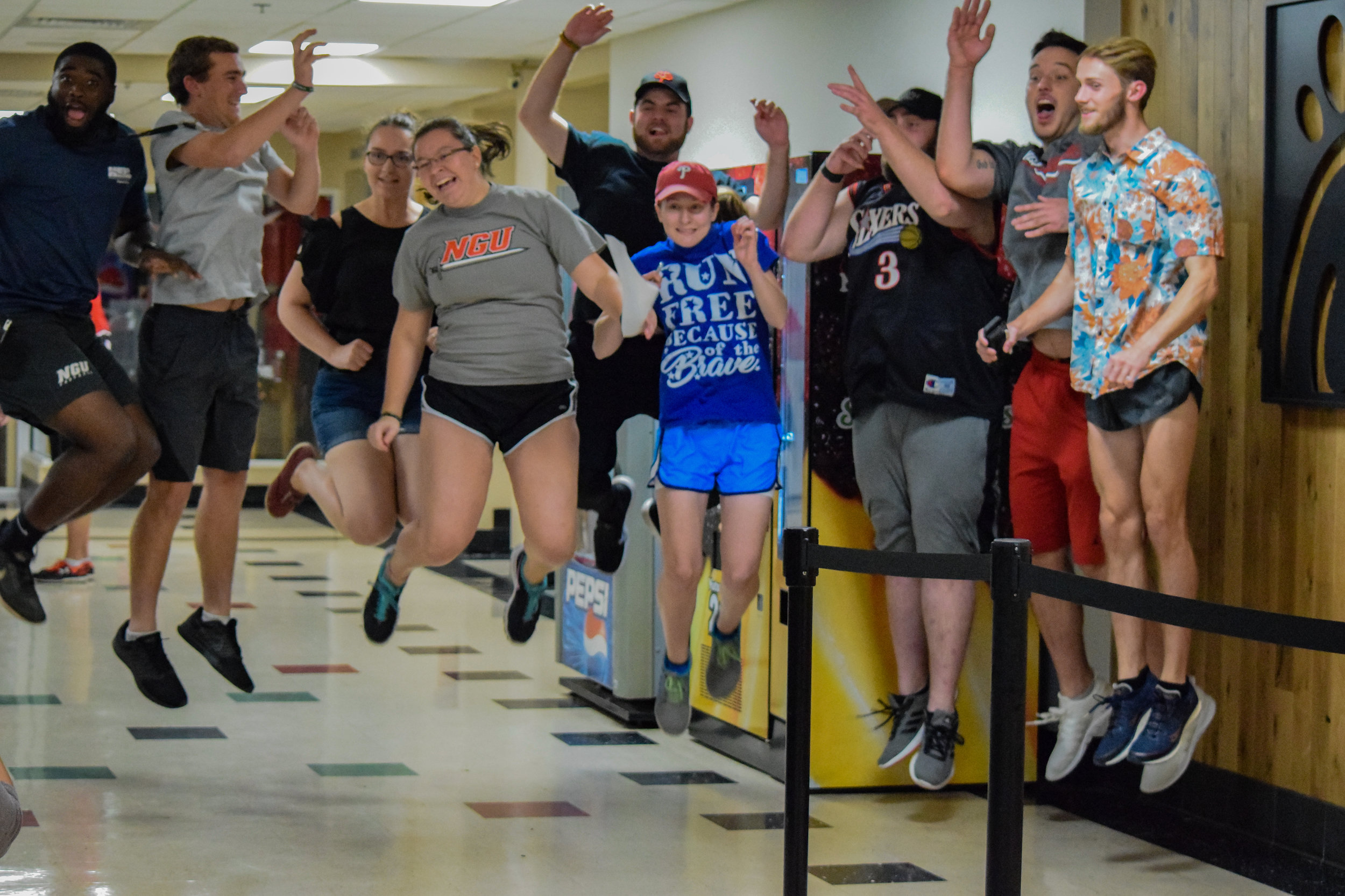 The criminal justice club jumps for joy as they get ready to set off on the race.