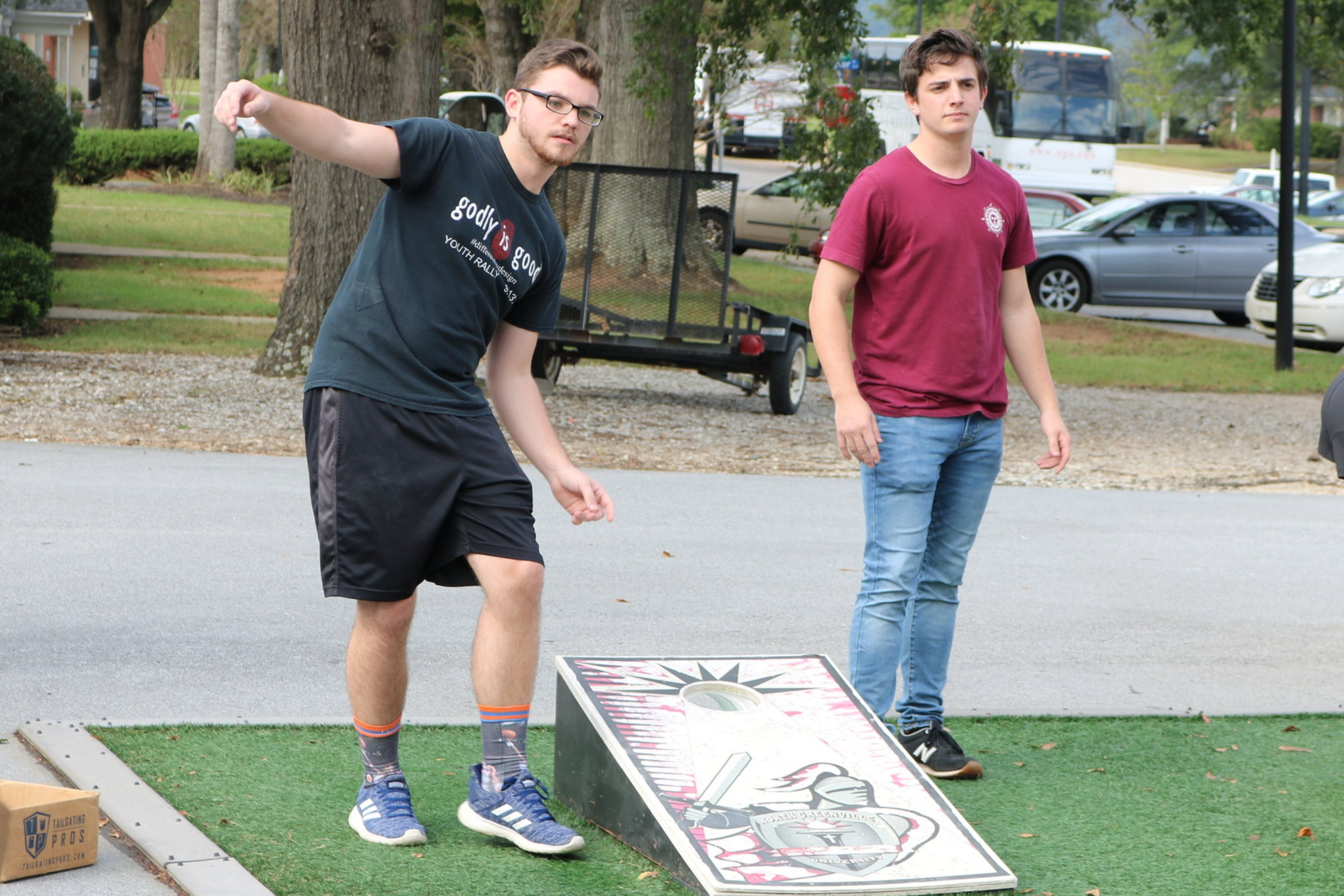 Junior, Jonny Hannah and senior, Jon Andrews are focusing in on winning for their clubs when playing in the Corn-Hole Tournament Tuesday afternoon.