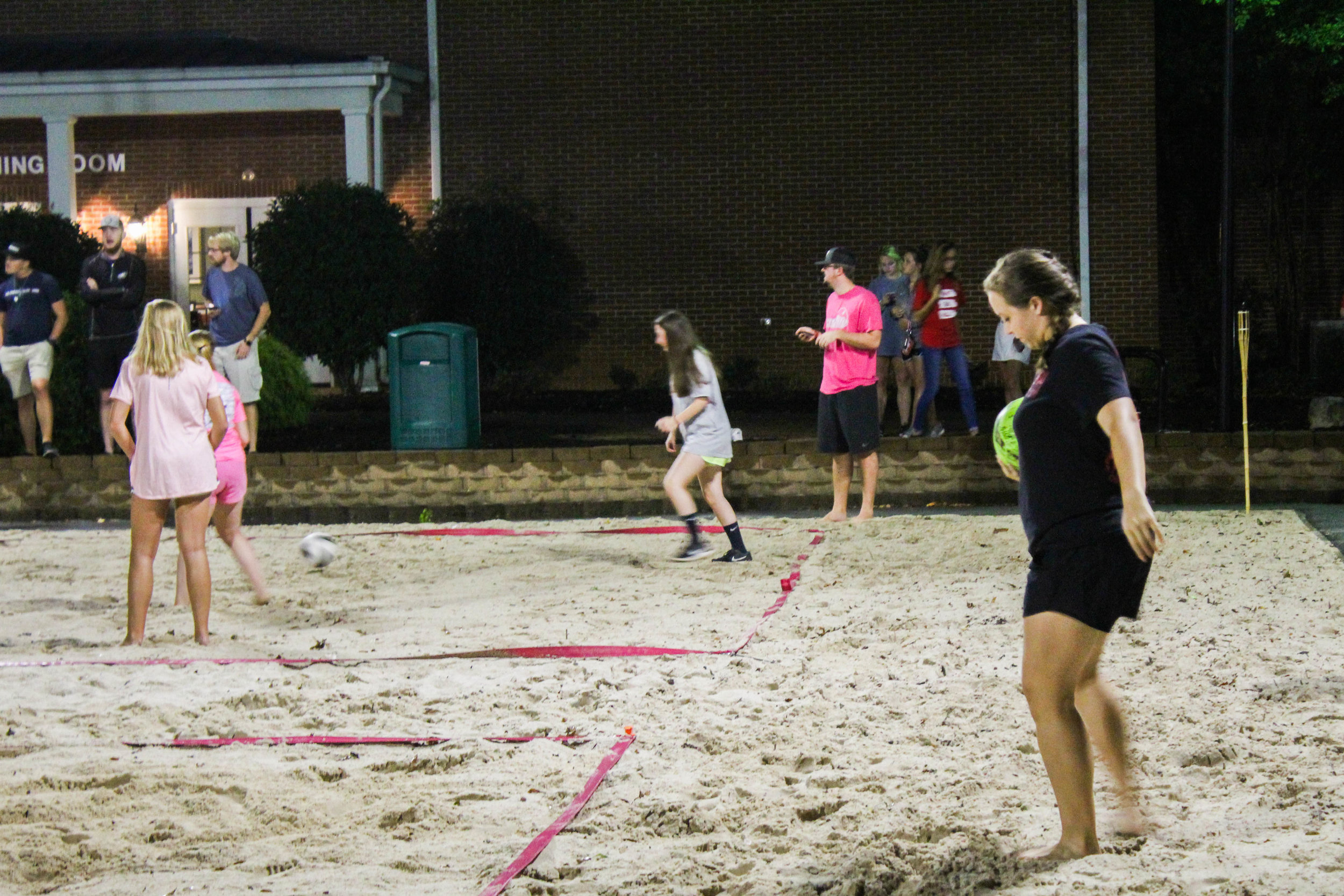 A member of the animal science club gets ready to serve the ball toward the campus ambassador team.