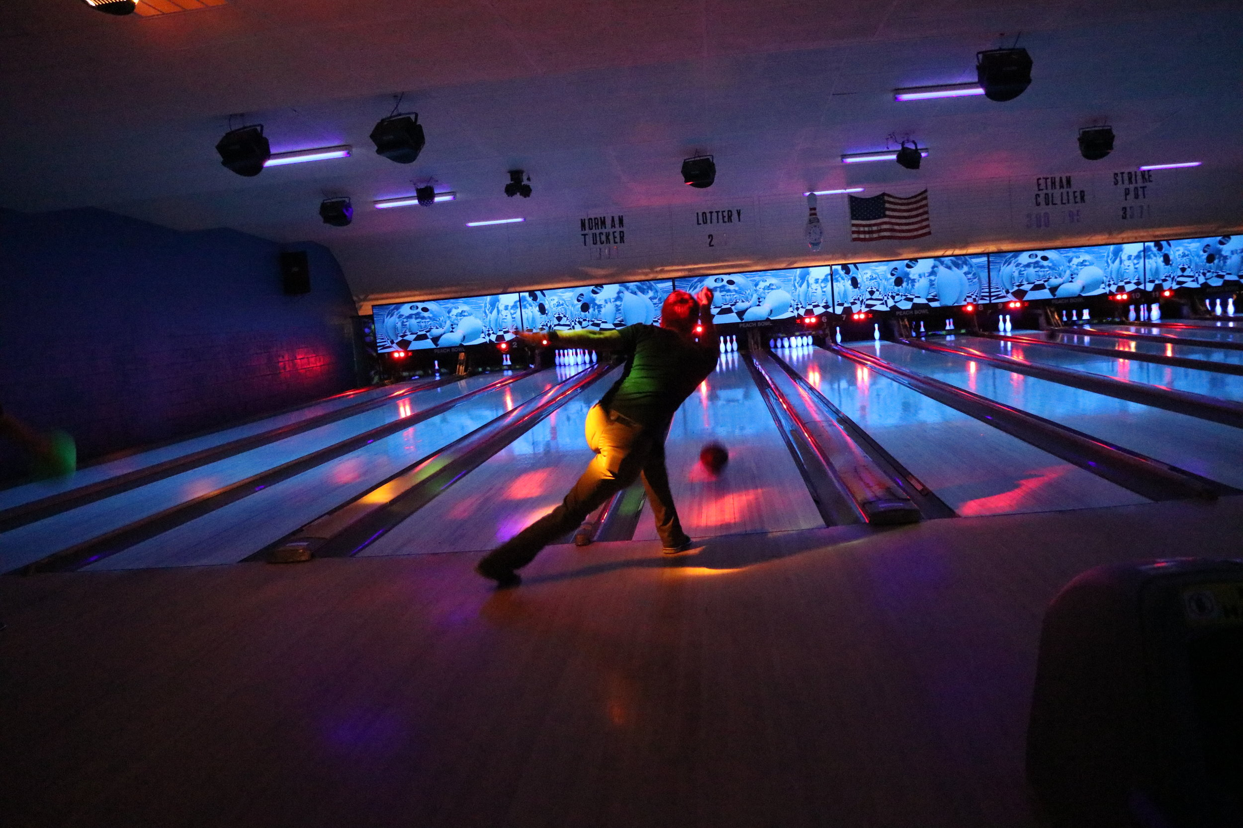 Junior, Carson Floyd, shows off his skills as he attempts to roll a strike.
