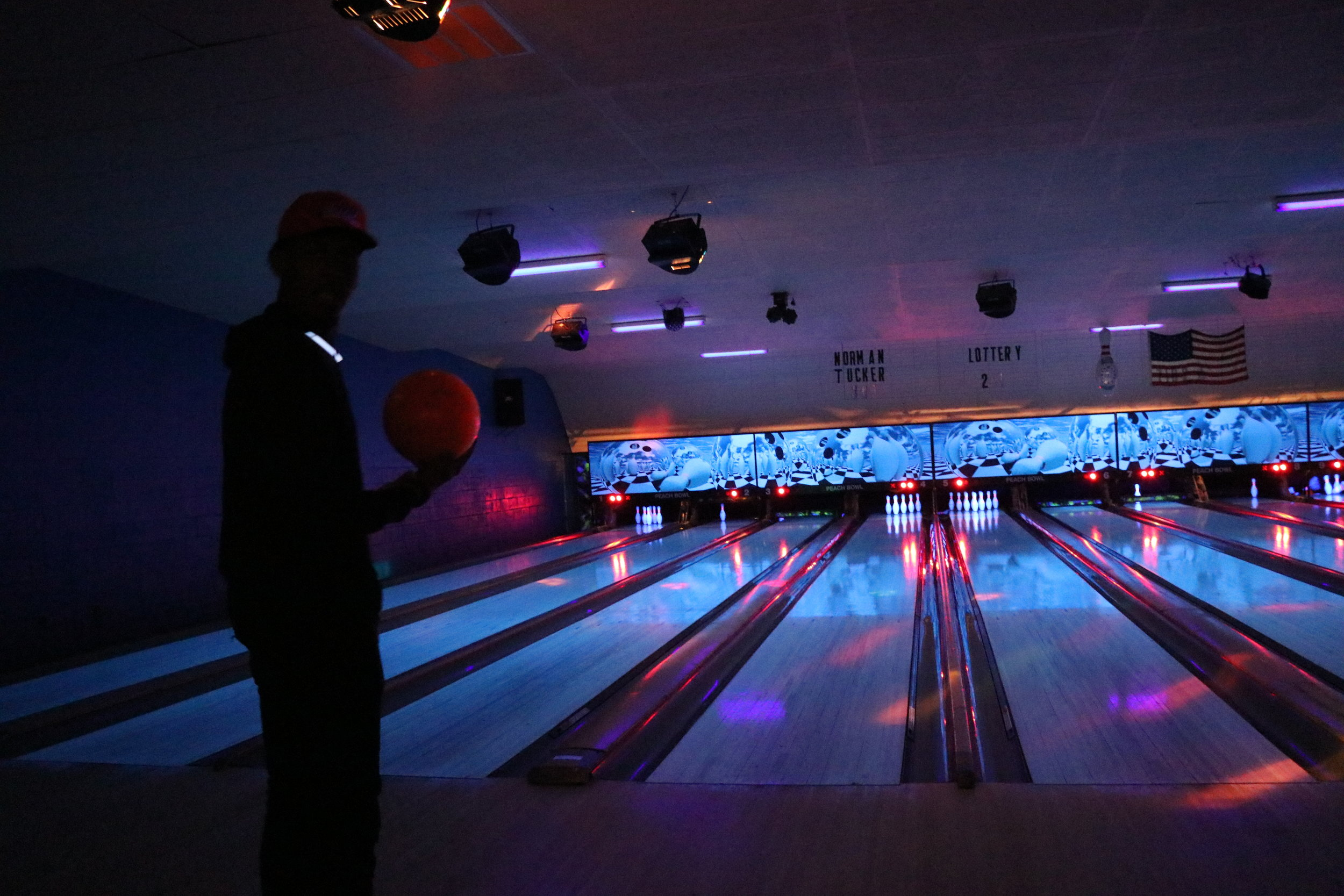 Sophomore, Zion Dendy, gets ready to bowl as he pauses to gain concentration on the game.