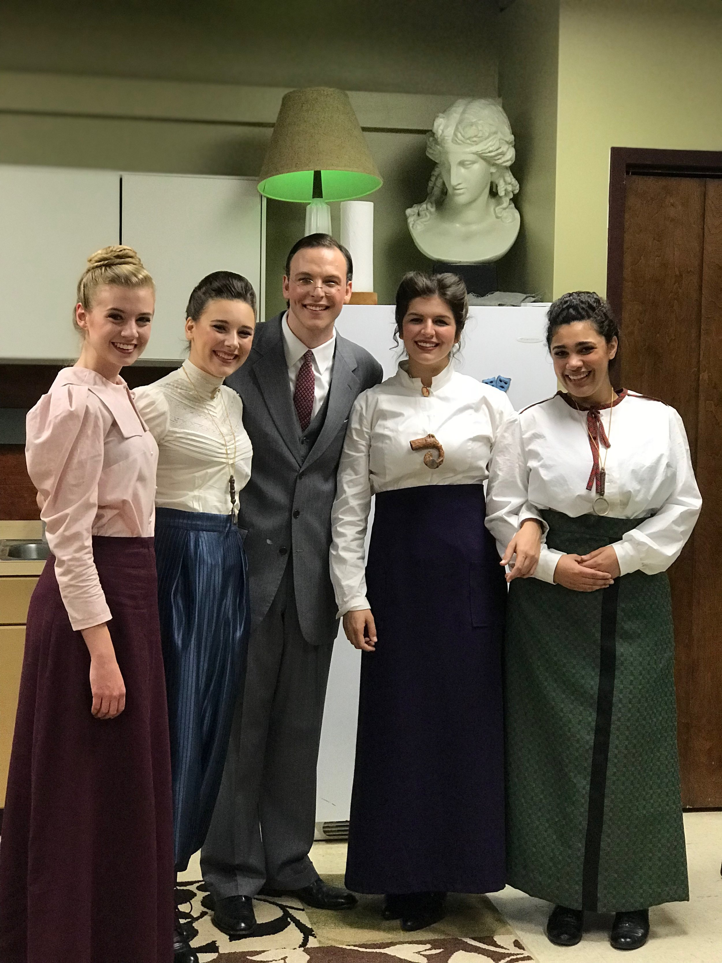 The cast members paused from dressing out of their costumes to pose for a group photo after the play.  From left to right: Abby Gilbert (sophomore), Rachel Gasdia (sophomore), Tanner Dean (junior), Emily Smith (senior) and Cassie Scott (senior).