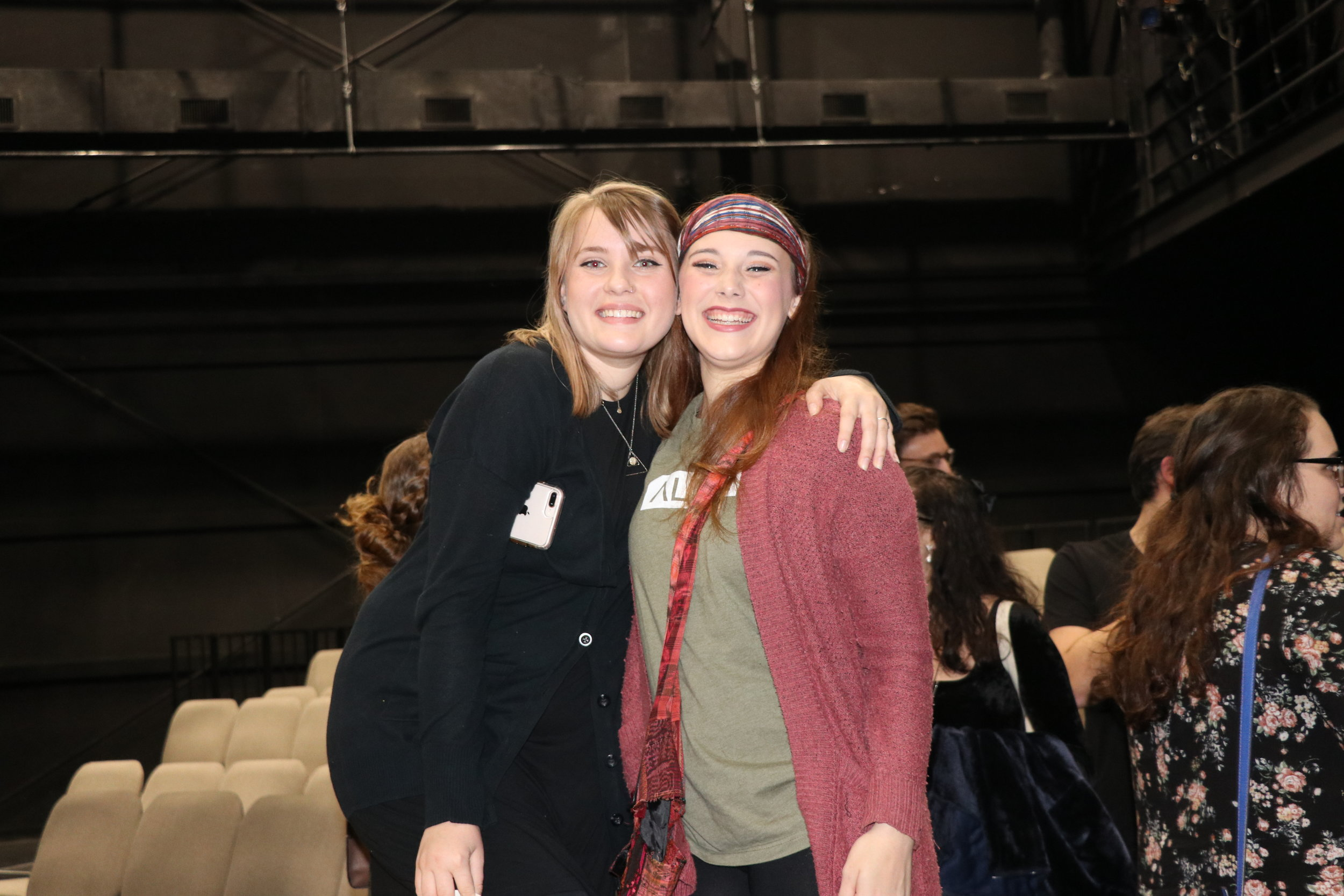 Marlee Daniel, assistant stage manager (sophomore) and Rachel Gasdia (sophomore) hug it out after killing it on opening night.