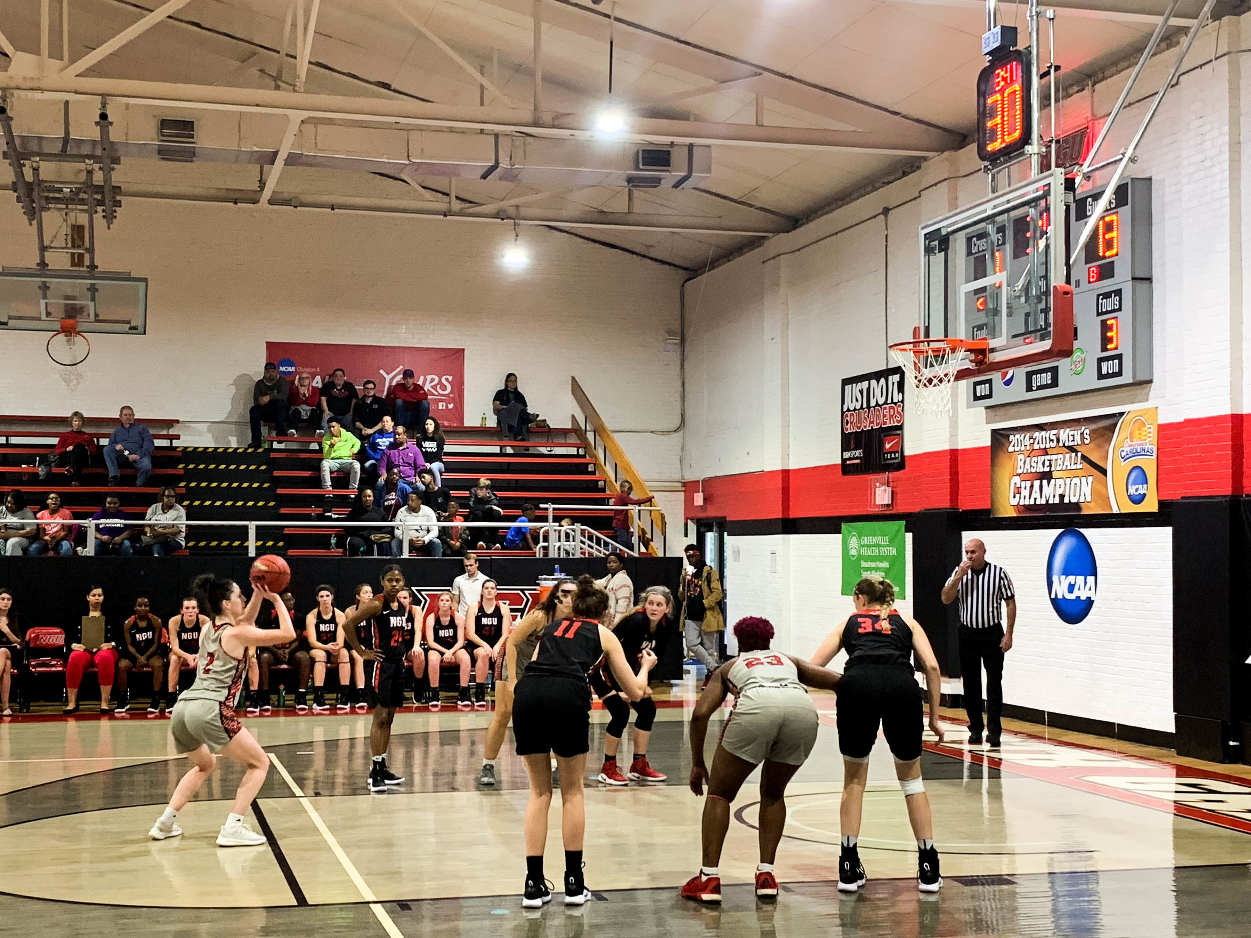 Senior Kyli Schmitt (11) and sophomore Bailey Breazeale (34) box out as a Newberry College player shoots a free throw.