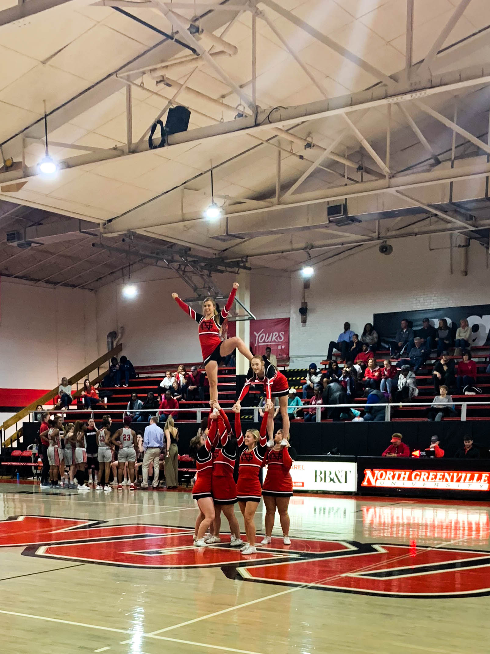 After the first quarter, the NGU cheerleaders perform a stunt at half court.
