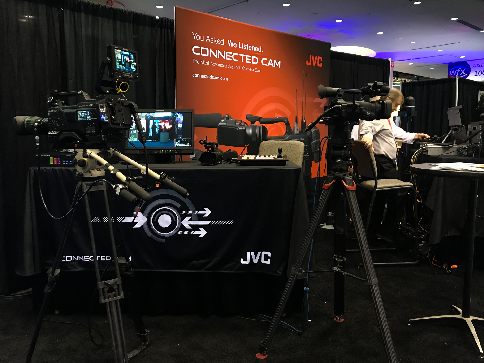 JVC is a company that sells different types of media equipment. Here they displayed some of their newest cameras to entice video team members.