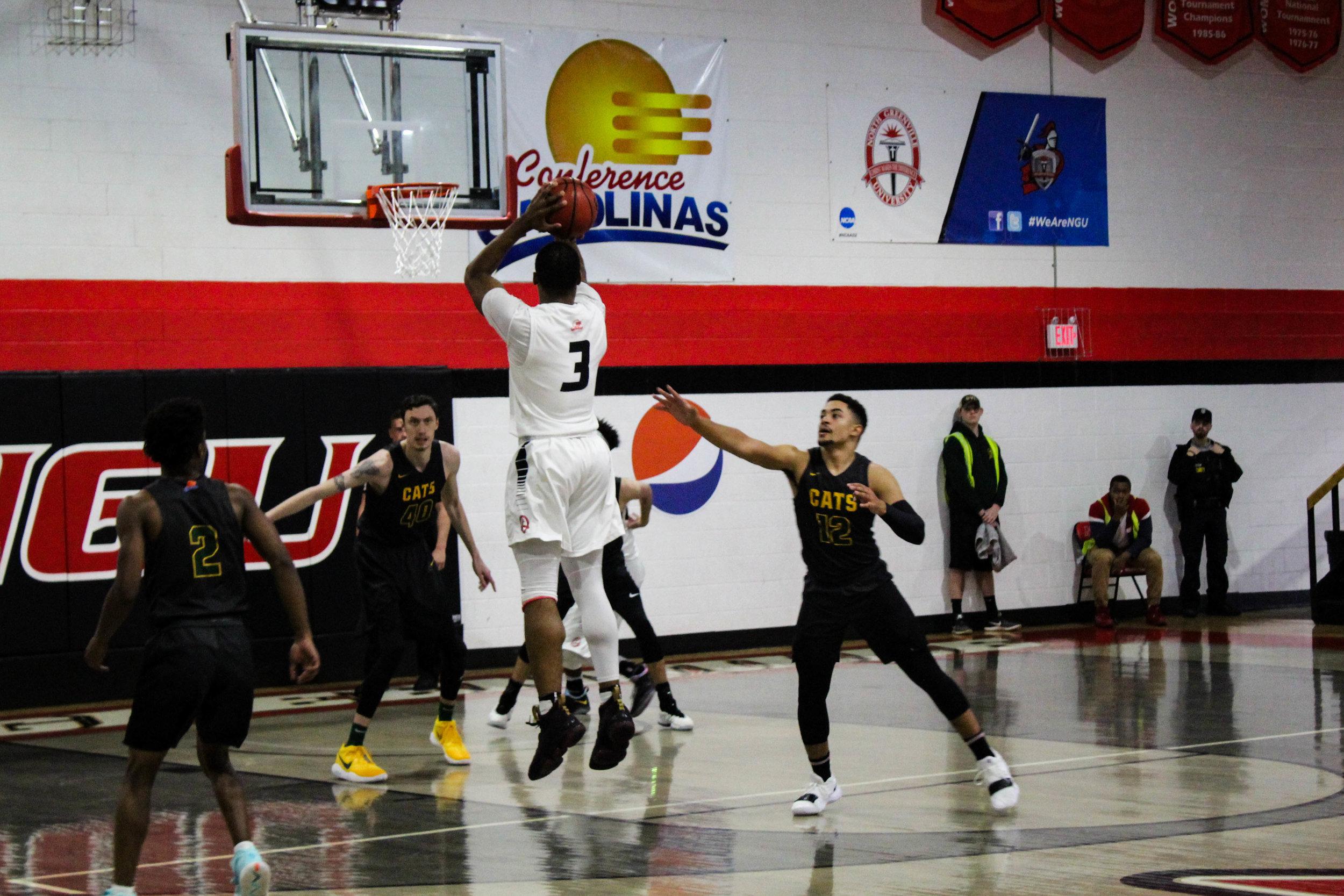 Sophomore Kovi Tate (3) jumps to shoot a three pointer.