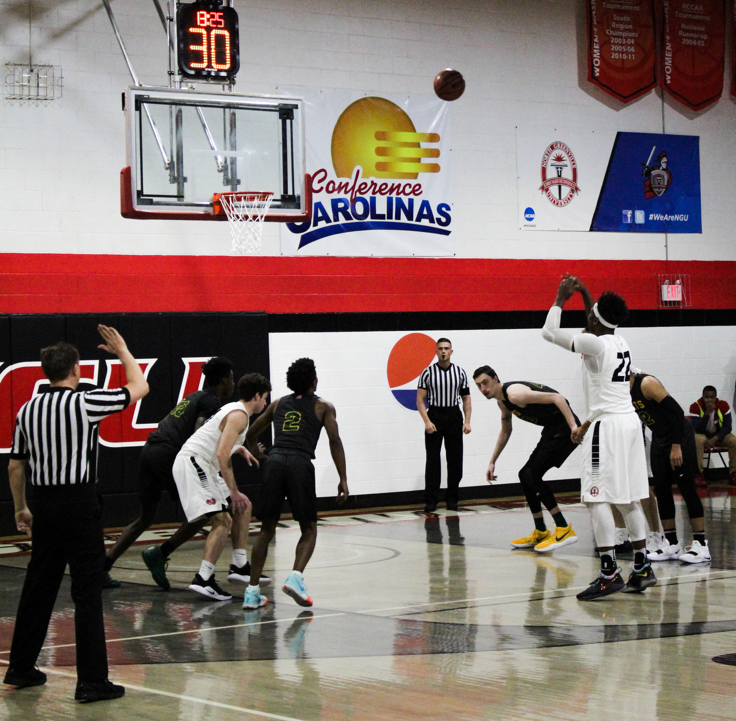 After being fouled while shooting, Roderick Howell (22), a senior at NGU, shoots and makes a foul shot.