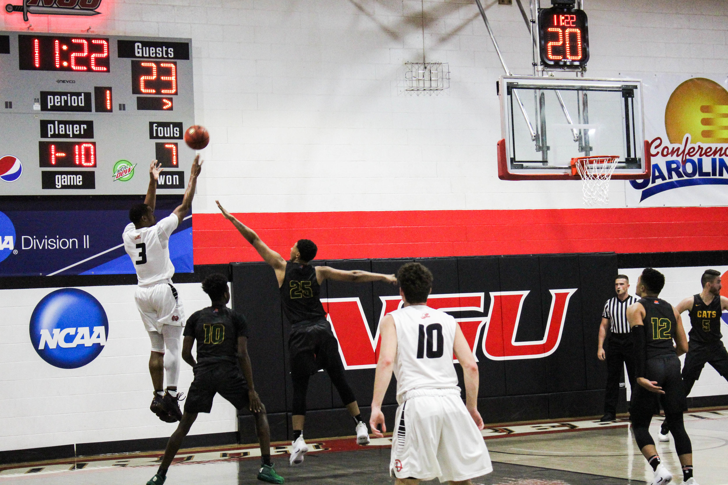 Sophomore, Kovi Tate (3) shoots a three pointer with twenty seconds left on the shot clock.
