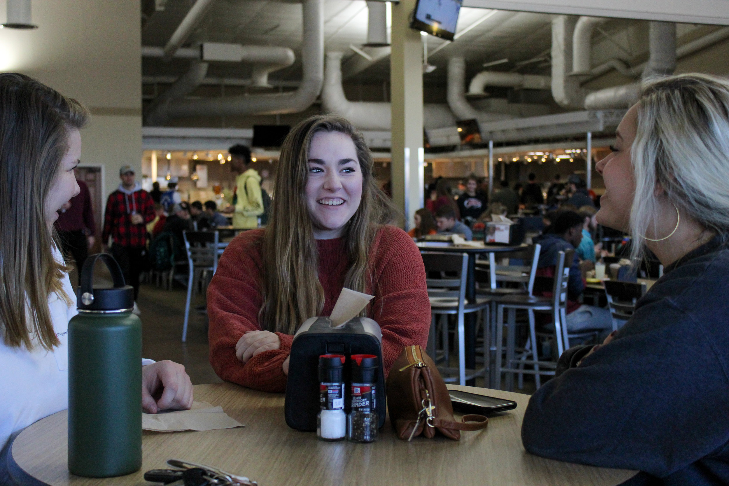 Freshmen Tess Shirley, Lauren Blackwell, and Abby Swindal socialize in the Caf before lunch.