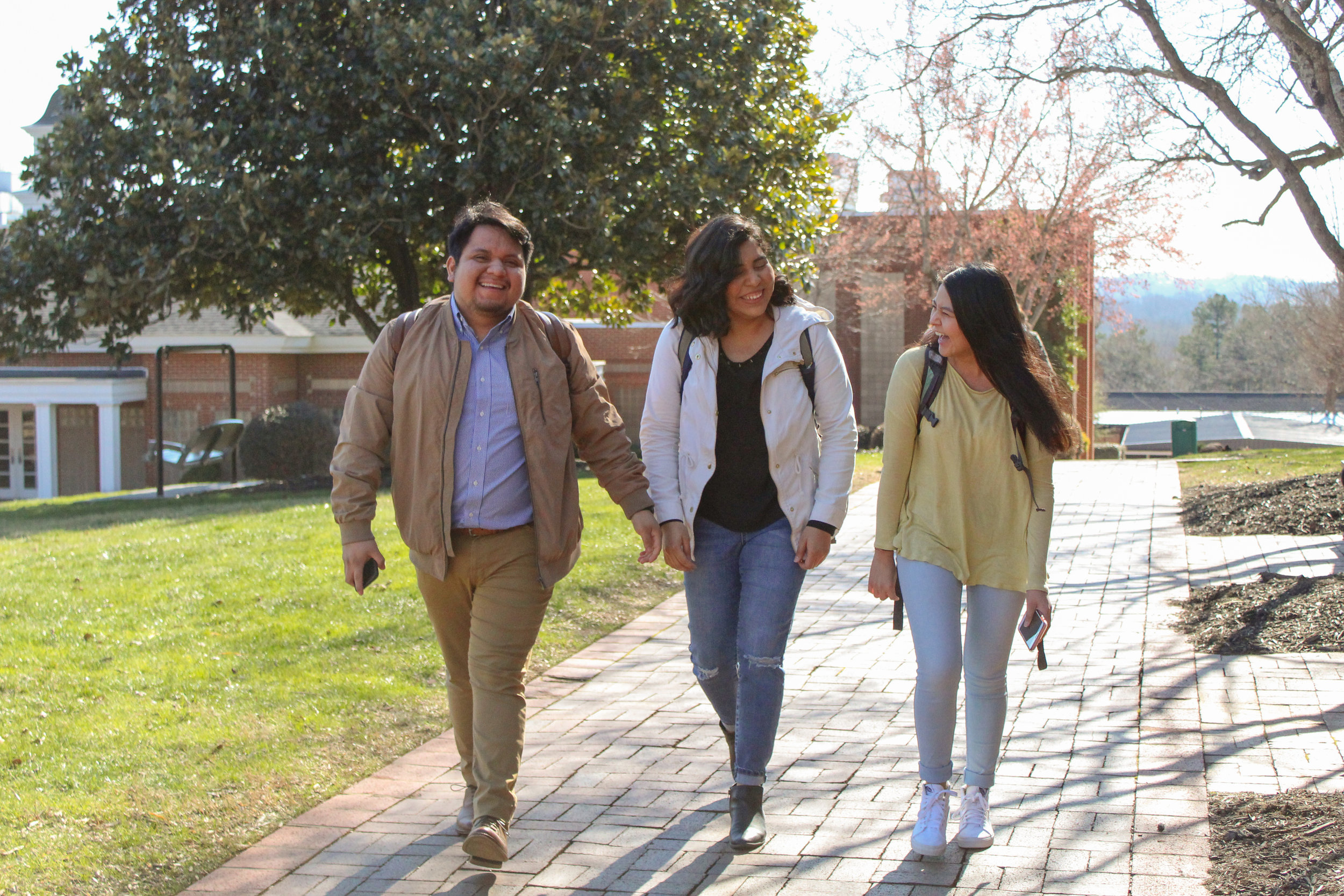 Senior Luis Travis, freshman Vanessa Martinez, and sophomore Mary Garcia catch up while walking to their next class.