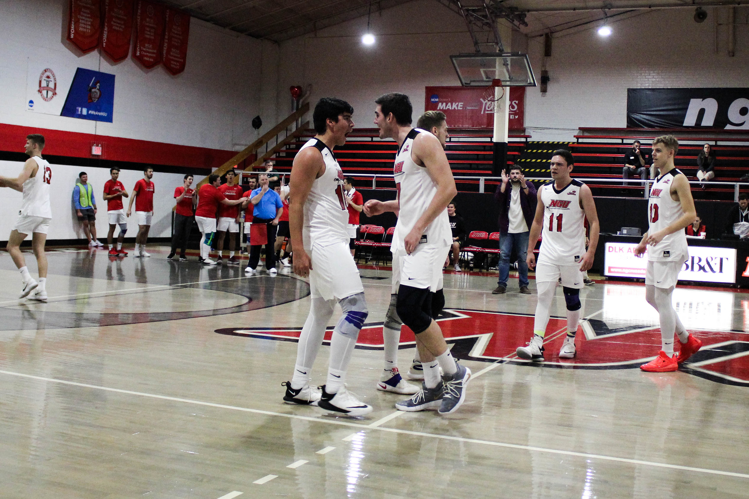 Freshman Sergio Carrillo (16) and junior Jackson Gilbert (7) celebrate together after Carrillo scored a point for the team.