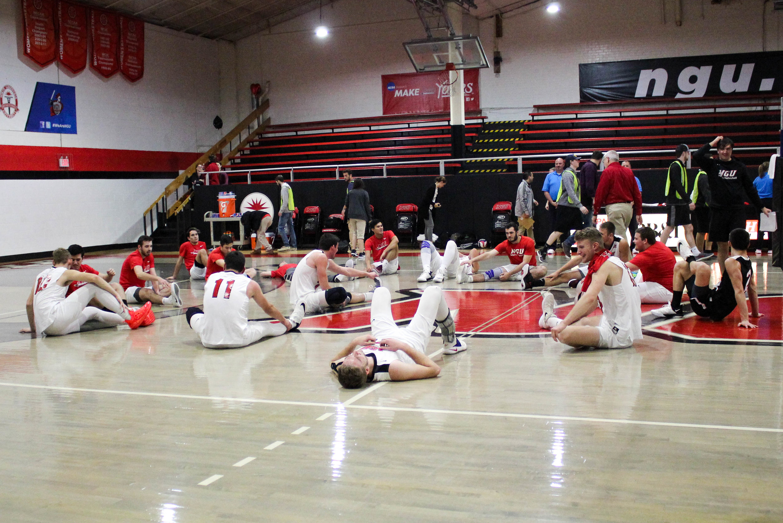 After all five sets, the team sits on the ground to stretch.