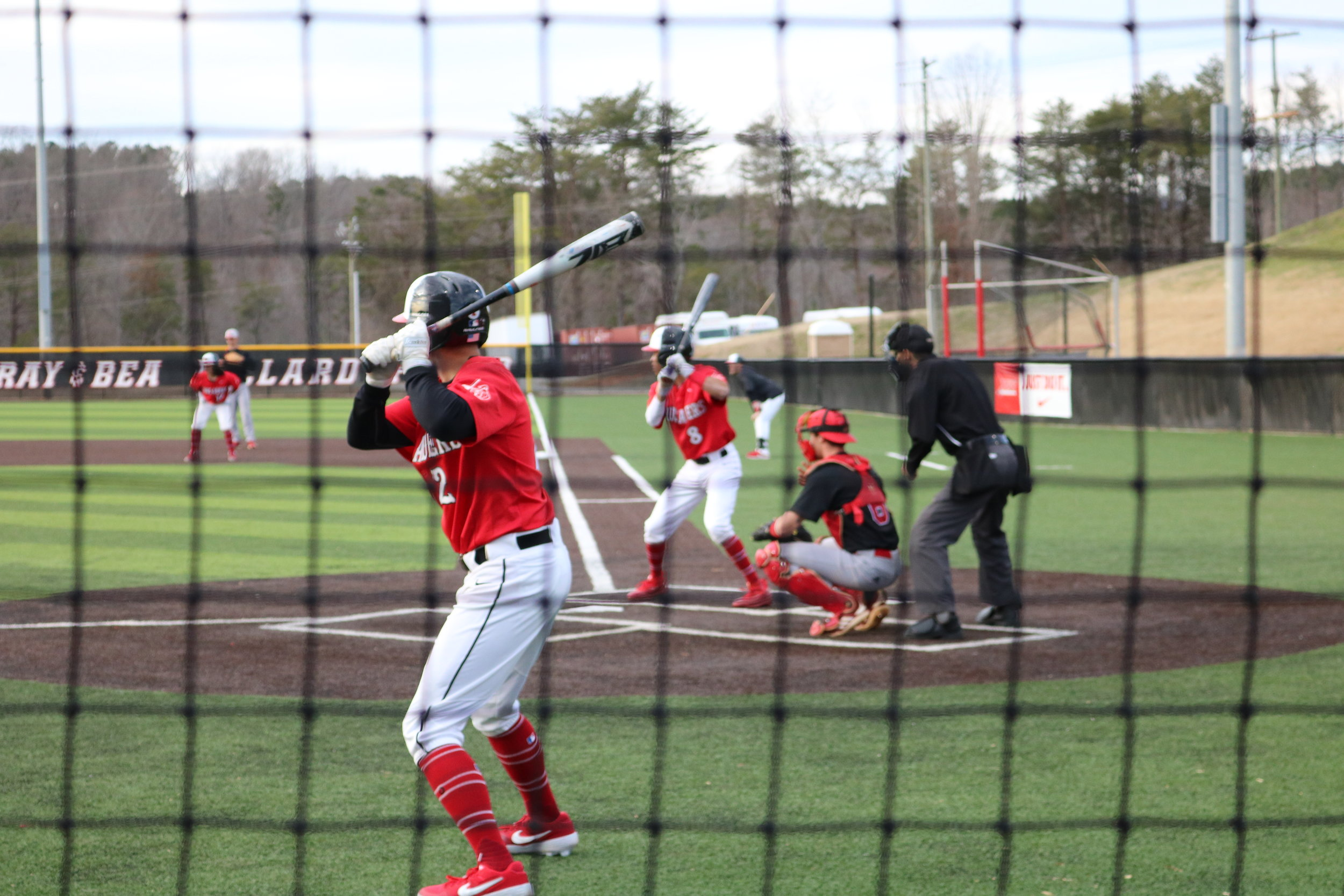 Senior Utah Jones (2), practices his swing while waiting to bat after Whitehead.
