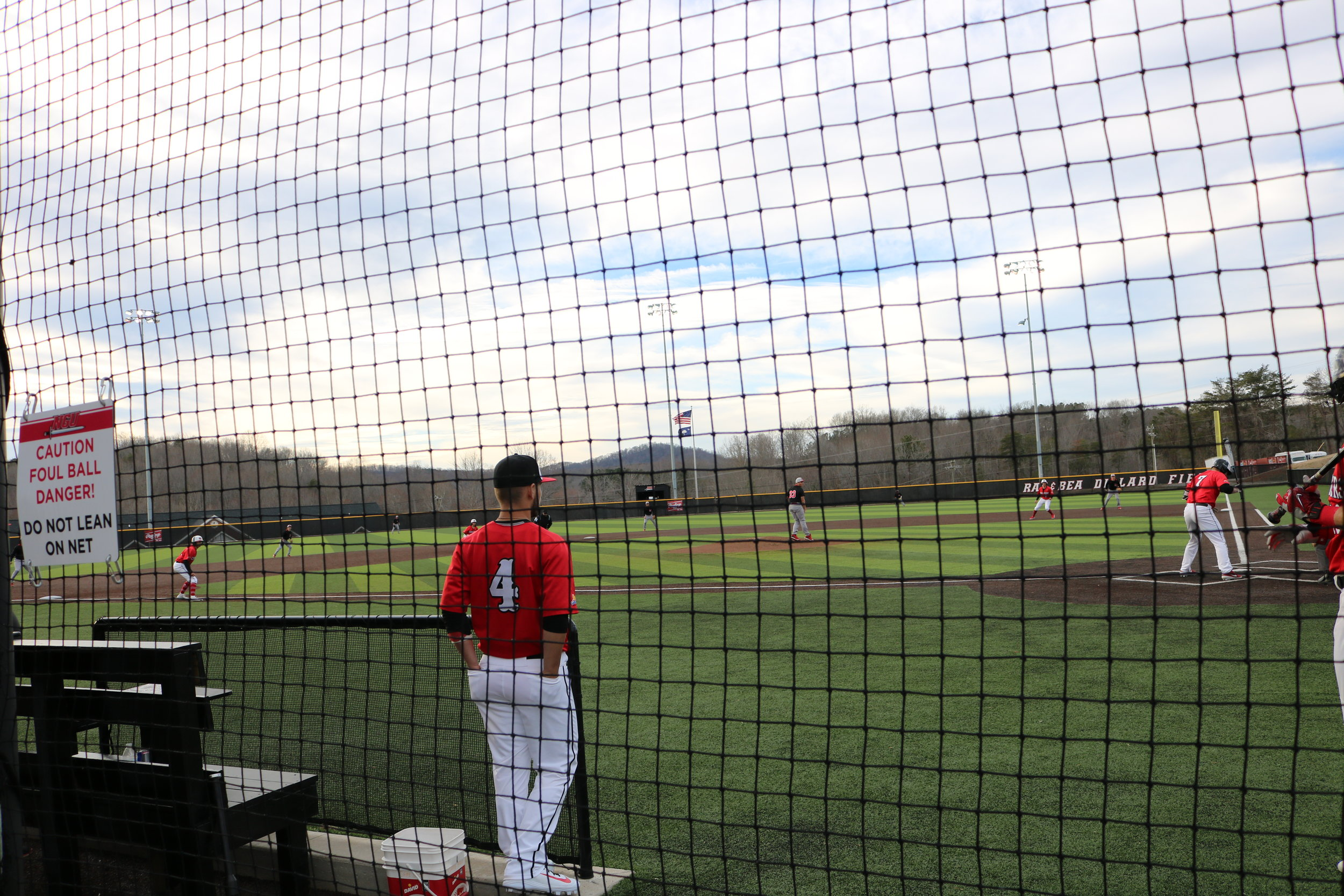 Junior Michael Neustifter (7), gets ready for the pitch, with bases loaded, while Freshman Palmer Sapp (4), watches Neustifter.