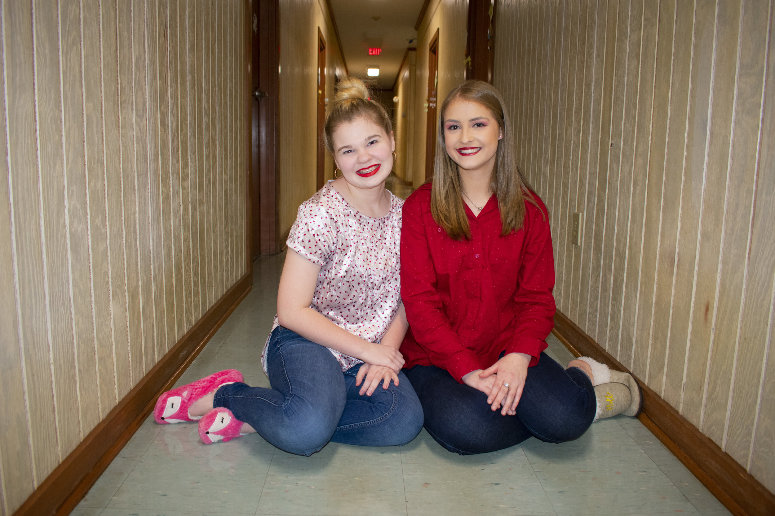 Hansen and Freshman Mary-Katherine Sizemore have an impromptu photoshoot in front of their dorm room in the Horton-Tingle residence hall.