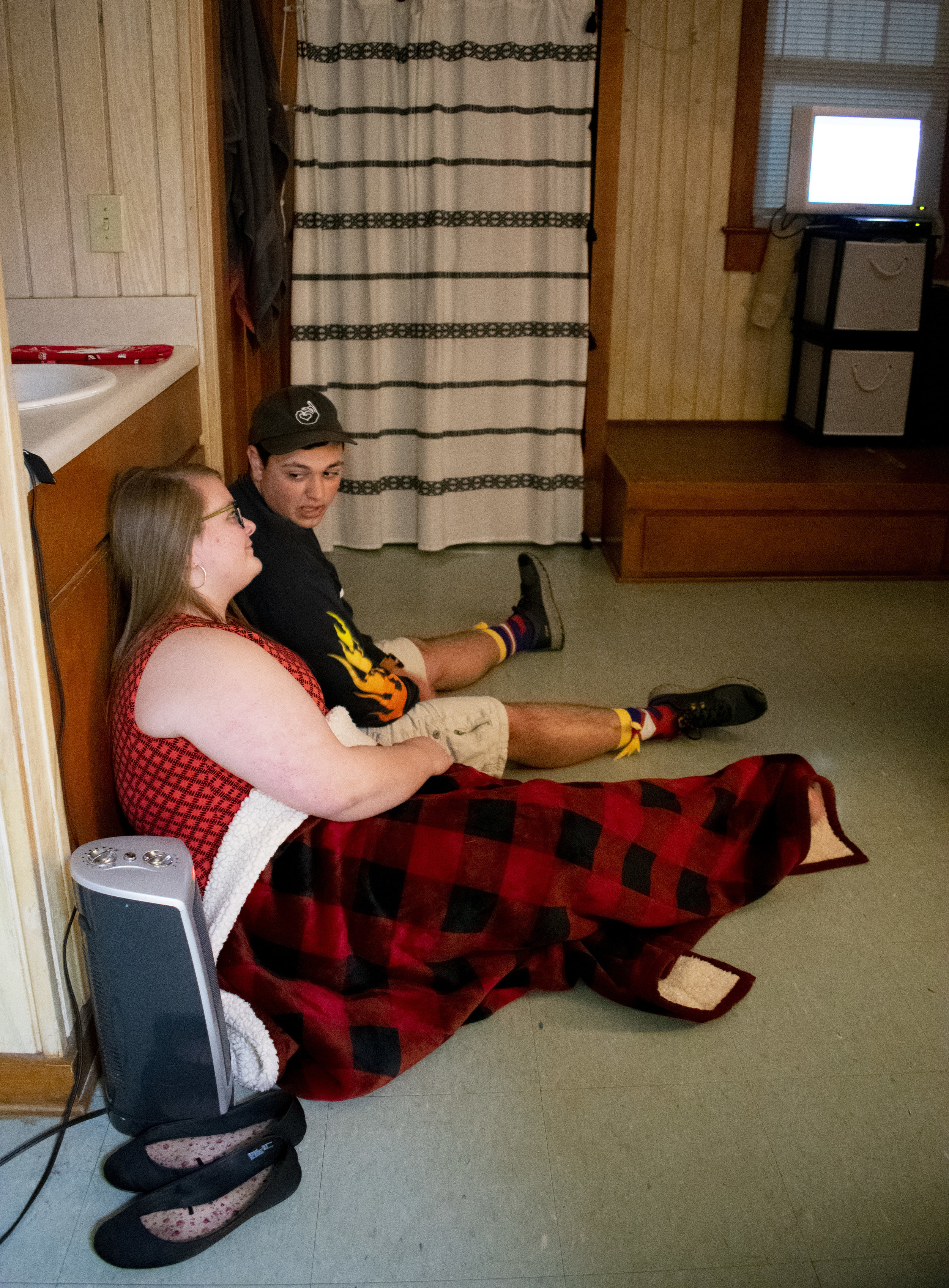 Freshmen couple Sarah Wylie and Will Winstead spend time together in a friend's dorm by watching the movie,  Brave .