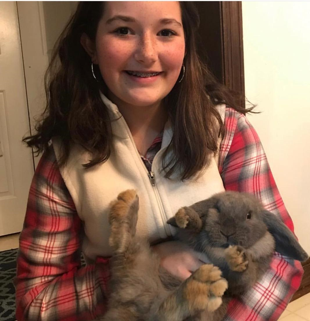 Maddie Petty (8th grade) with her rabbit, Gypsy.