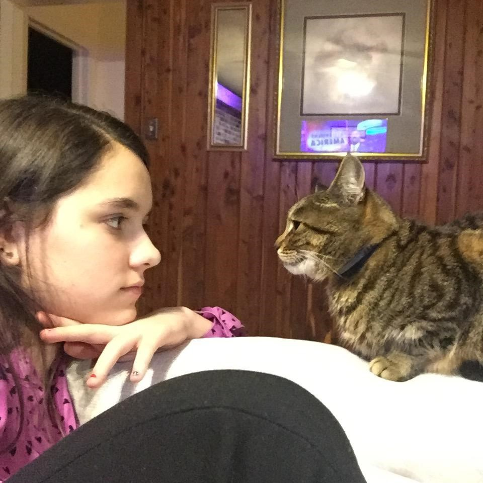 Charlotte Watson, seventh grade, with her cat Lucky. Lucky, now about eight years old, was hit by a car as a kitten, and now spends most of her time sleeping and staring at walls.