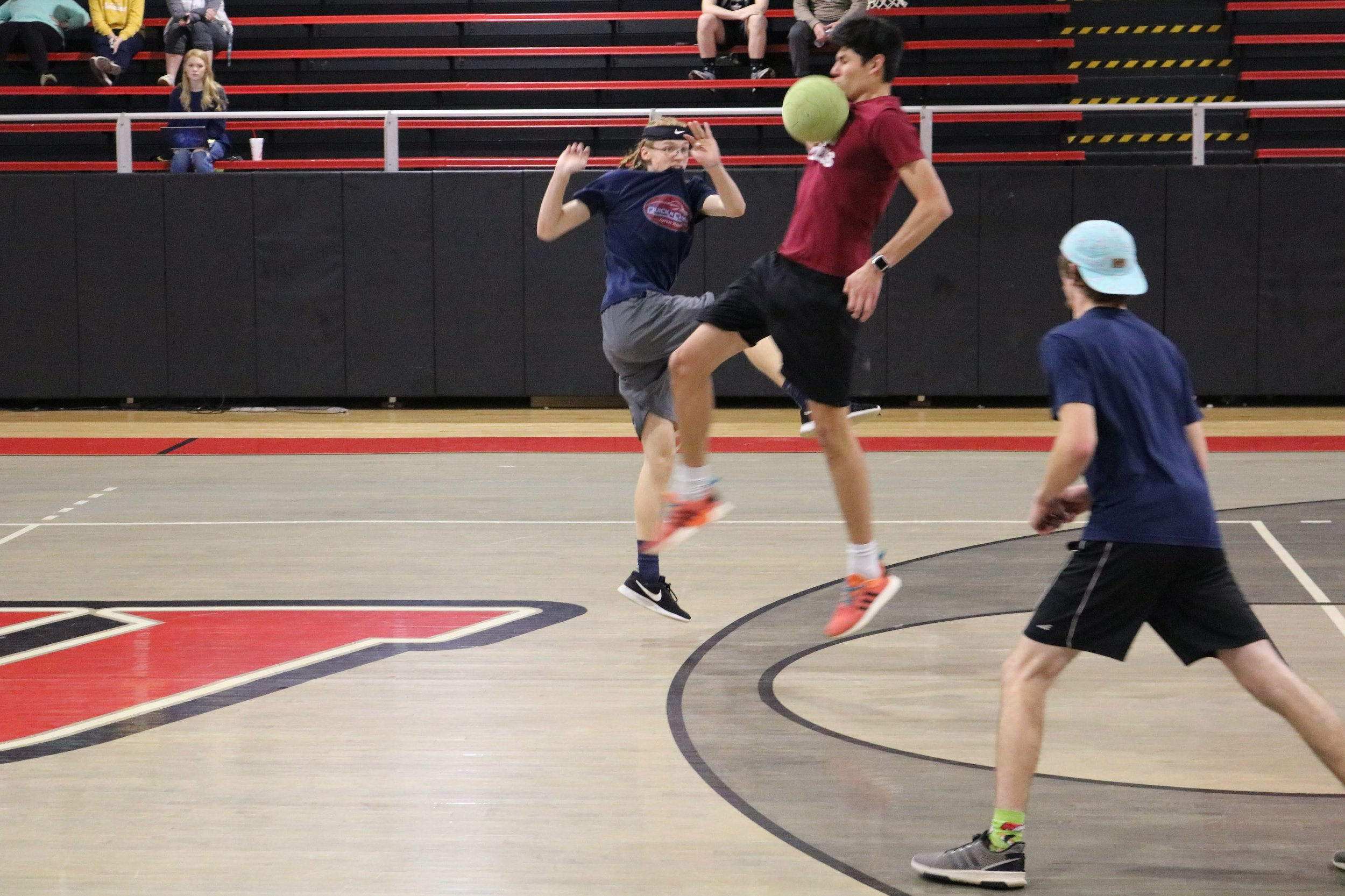 Freshman Shaun Forrester and Freshman Isaac Aliaga fight for control of the ball while Reynolds looks on to see if he can offer any assistance.