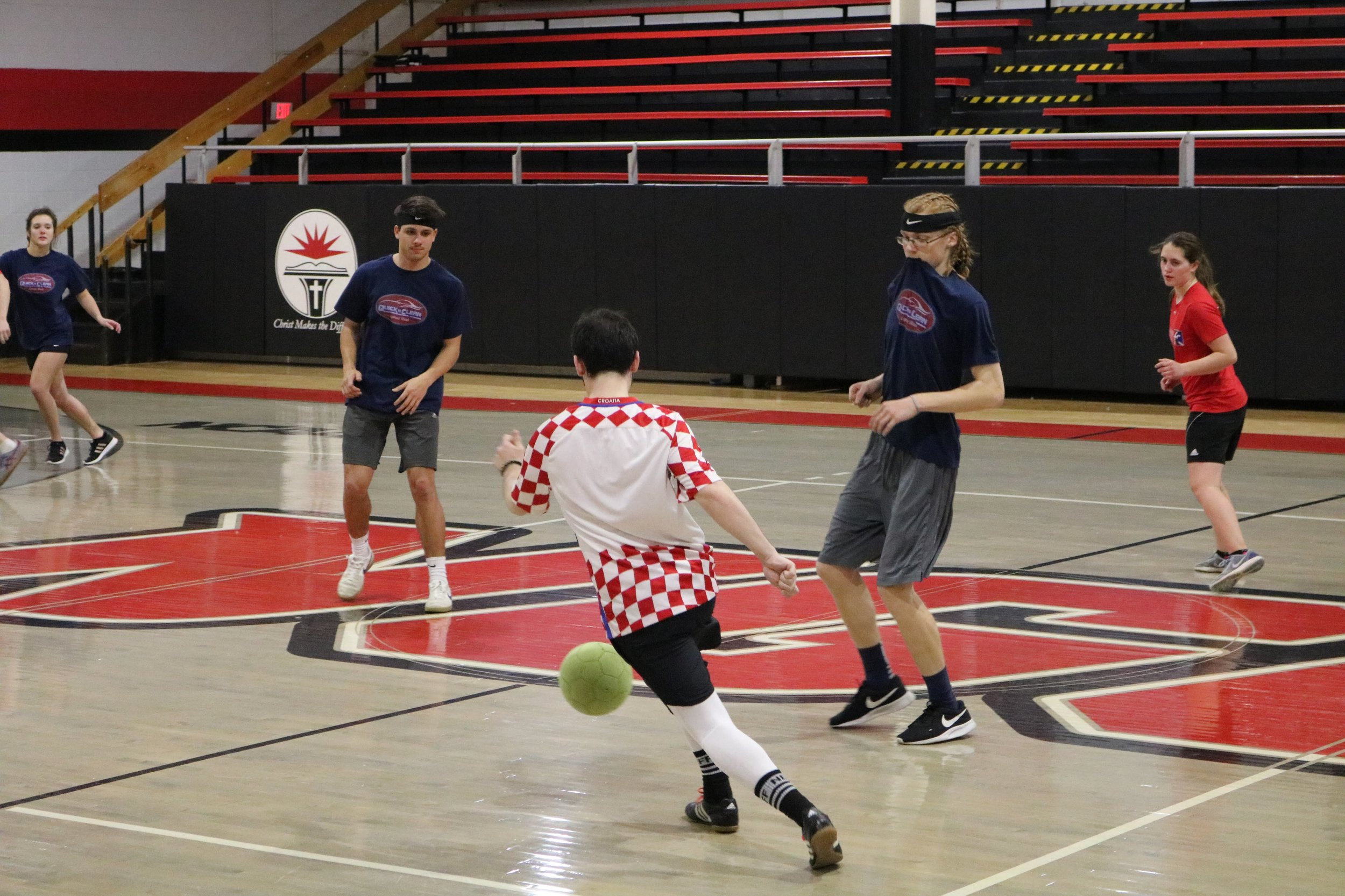 Green kicks the ball down the court as Freshman Camden Kendrick and Forrester look on to see if they can steal the ball away.