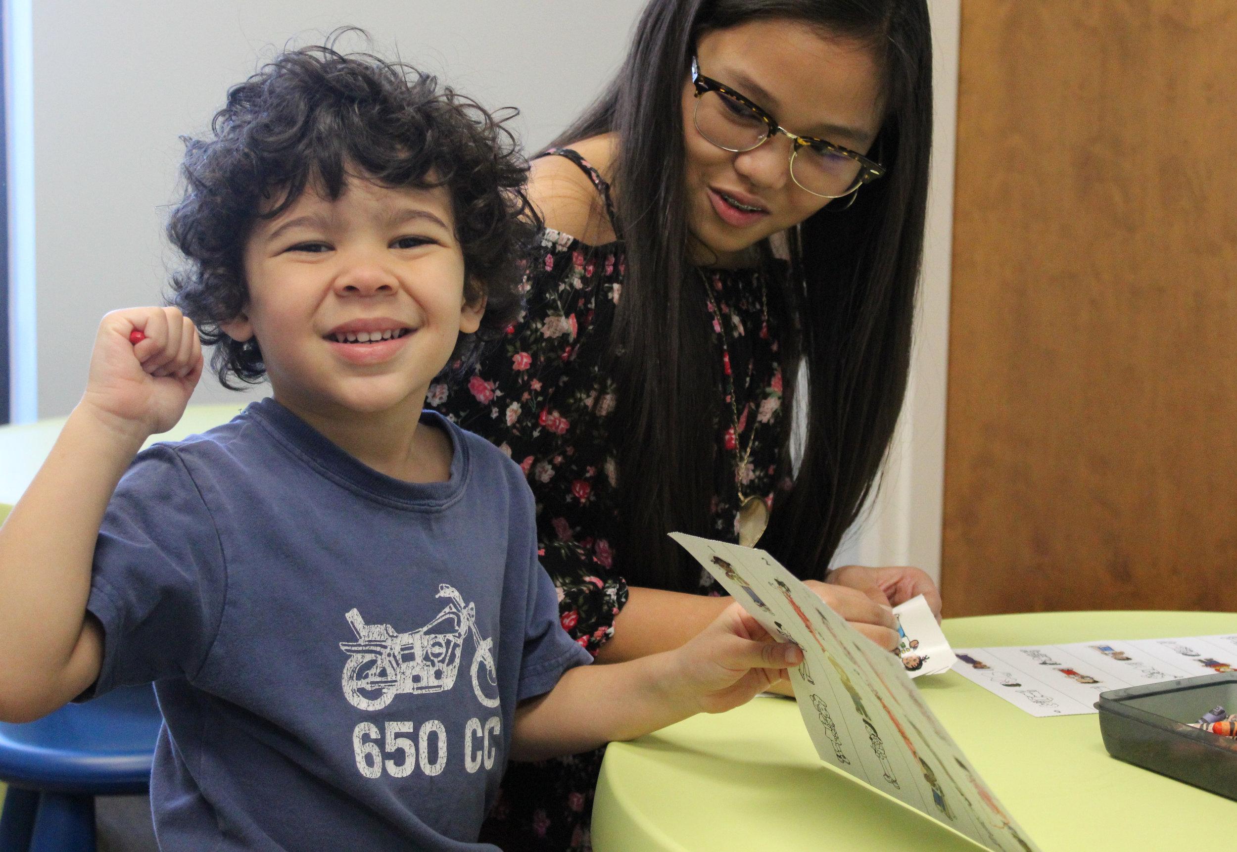 Kristen Pili teaches Owen Pringle about the twelve disciples in Toddler Trinity Kids.